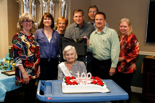 "(Seated) Regina ""Jean"" Luciano; with son Nick Luciano (second from right) with wife Joann (far right); son Frank Luciano (behind Regina ""Jean"" Luciano) and wife Pam (far left); son Tom Luciano (in back) with wife Susan (third from left); and daughter Jean Schwartz (second from left)."