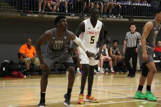 Class of 2022 guard/wing Prince Aligbe boxes out during a game at the Under Armour Association Session II in Kansas City.