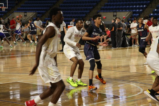 Class of 2021 combo guard Max Christie is defended during the Under Armour Association Session II in Kansas City.