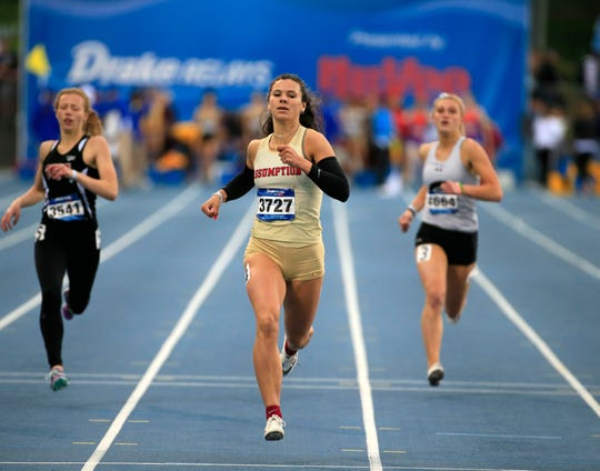 Carly King of Davenport Assumption wins the second heat of the girls 400 meter dash with a time of 56.55 at the Drake Relays Friday, April 26, 2019.