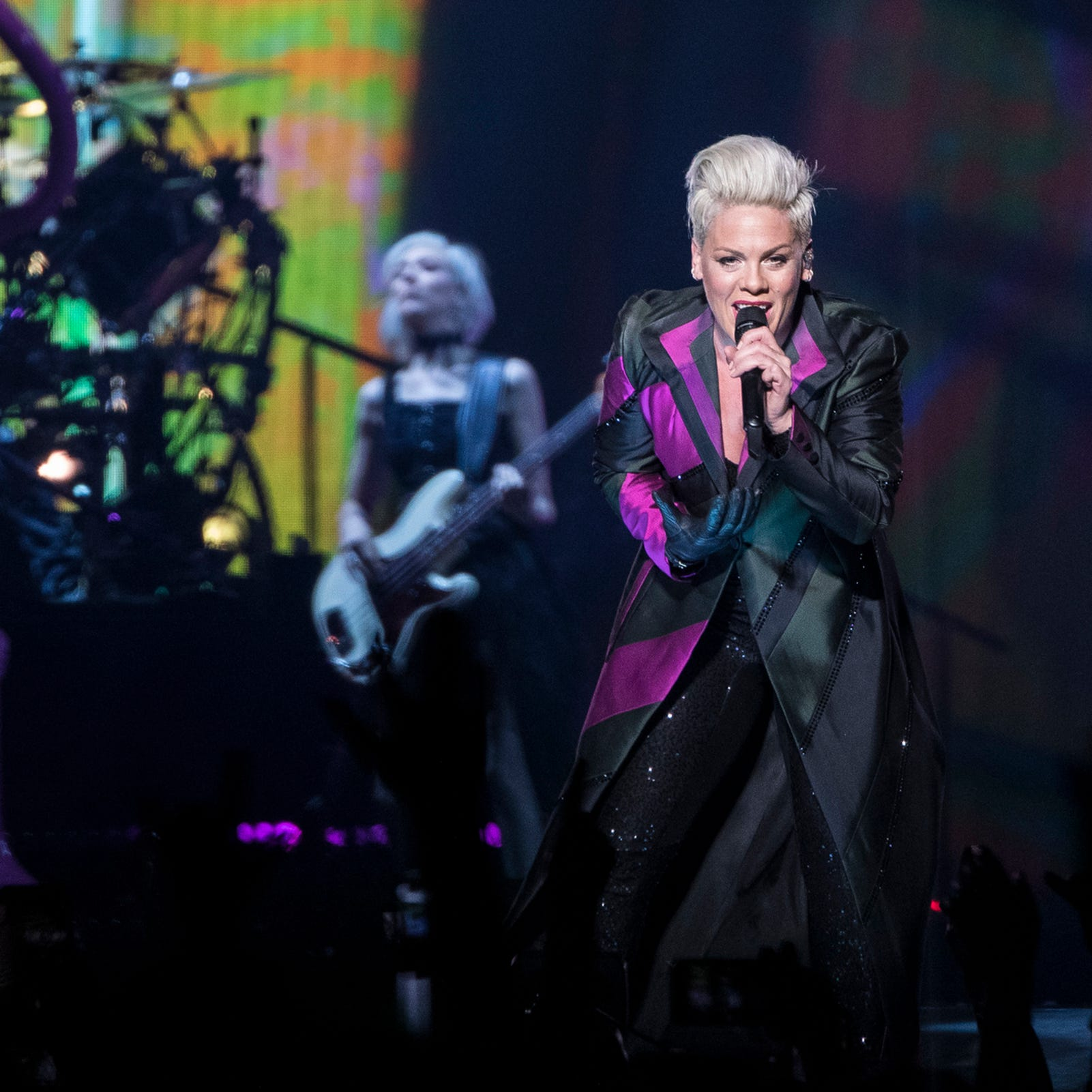 Pink soars — and keeps it down to earth — in long-delayed Detroit show