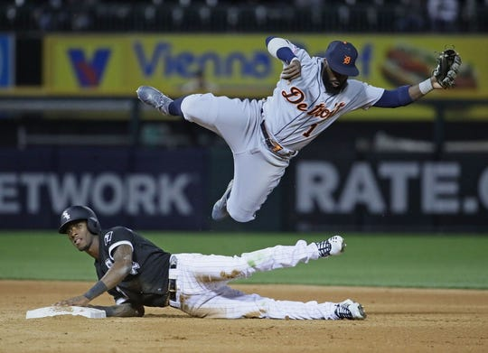 Tigers second baseman Josh Harrison leaps over White Sox shortstop Tim Anderson after trying to turn a double play in the 5th inning on Friday, April 26, 2019 in Chicago.