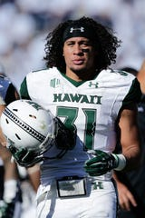Hawaii linebacker Jahlani Tavai in the fourth quarter against Air Force at Falcon Stadium, Oct. 22, 2016.