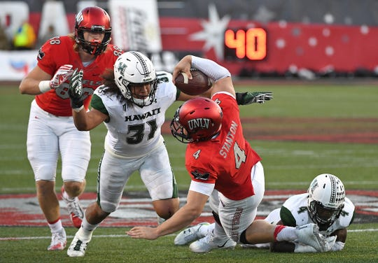 Hawaii's Jahlani Tavai (31) makes a tackle against UNLV, Nov. 4, 2017.