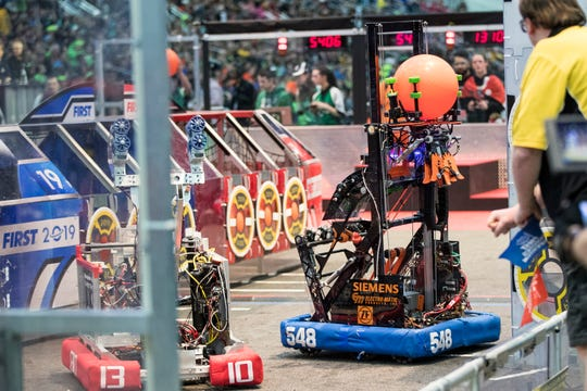 Robots from Team 548 Robostangs of Northville, and 1310 from Runnymede Robotics of Toronto compete during the FIRST Robotics World Championship semifinal at Cobo Center in Detroit, Saturday, April 27, 2019.