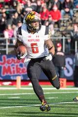 Maryland running back Ty Johnson runs with the ball against Rutgers on Nov. 4, 2017.