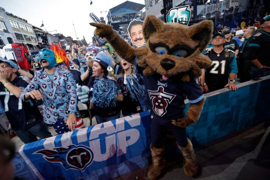 The Tennessee Titans mascot cheers with fans near the main stage during the second round of the NFL Draft on Friday night.