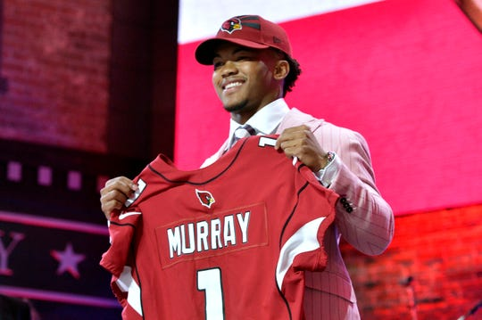 Oklahoma quarterback Kyler Murray holds his up a jersey after the Arizona Cardinals selected Murray in the first round.