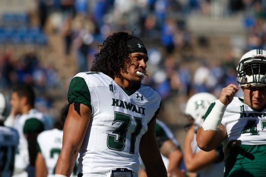Hawaii Warriors linebacker Jahlani Tavai (31) was projected by many as a fourth- or fifth-round pick.
