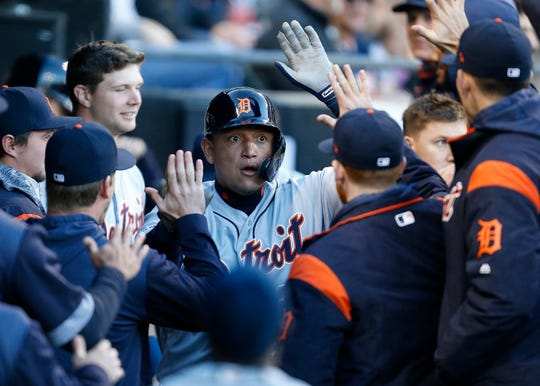 Detroit Tigers first baseman Miguel Cabrera is congratulated by teammates in the dugout following a solo home run against the Chicago White Sox during the first inning of Detroit's loss Friday night.