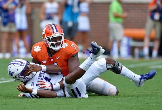 da484fca032 Furman quarterback Darren Grainger gets knocked down by Clemson s Austin  Bryant after scrambling out of the