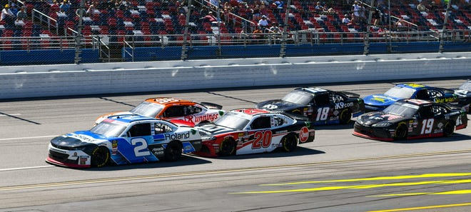 Tyler Reddick (2) leads the race in the final laps of a the Xfinity Series auto race at Talladega.