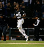 Chicago White Sox Tim Anderson celebrates his walk-off home run against the Detroit Tigers during the ninth inning Friday. The White Sox won 12-11.