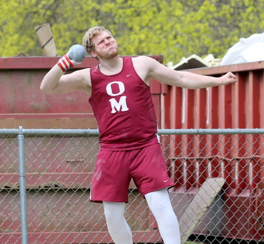Zach Elliott of Odessa-Montour competes in the shot put at the Waite-Molnar Invitational at Ernie Davis Academy on April 27, 2019.