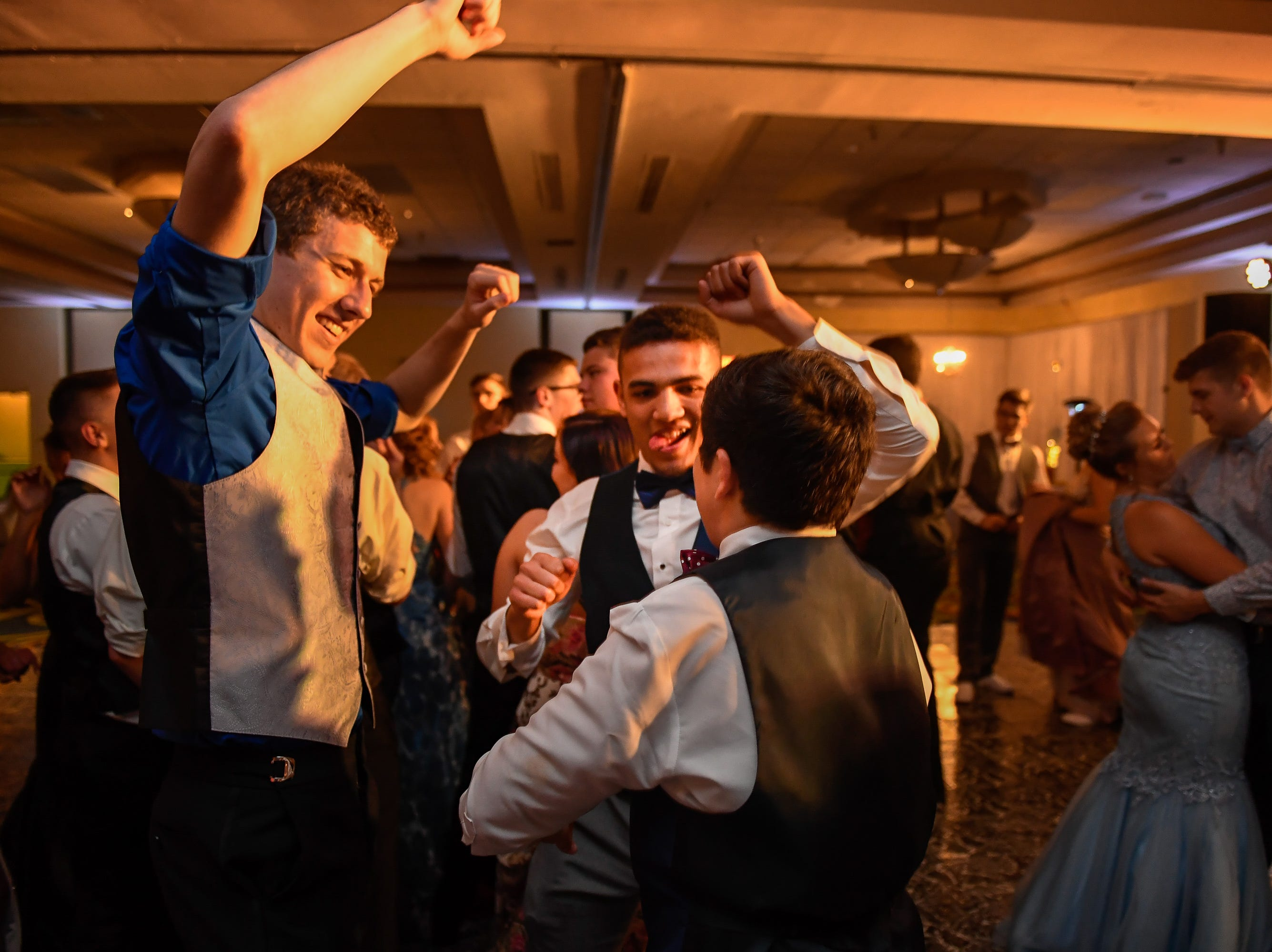 Left to right, Payton Buse, David Schafer and Camden Kemper on the dance floor at the Tecumseh High School prom held at the Airport Holiday Inn Friday, April 26, 2019.