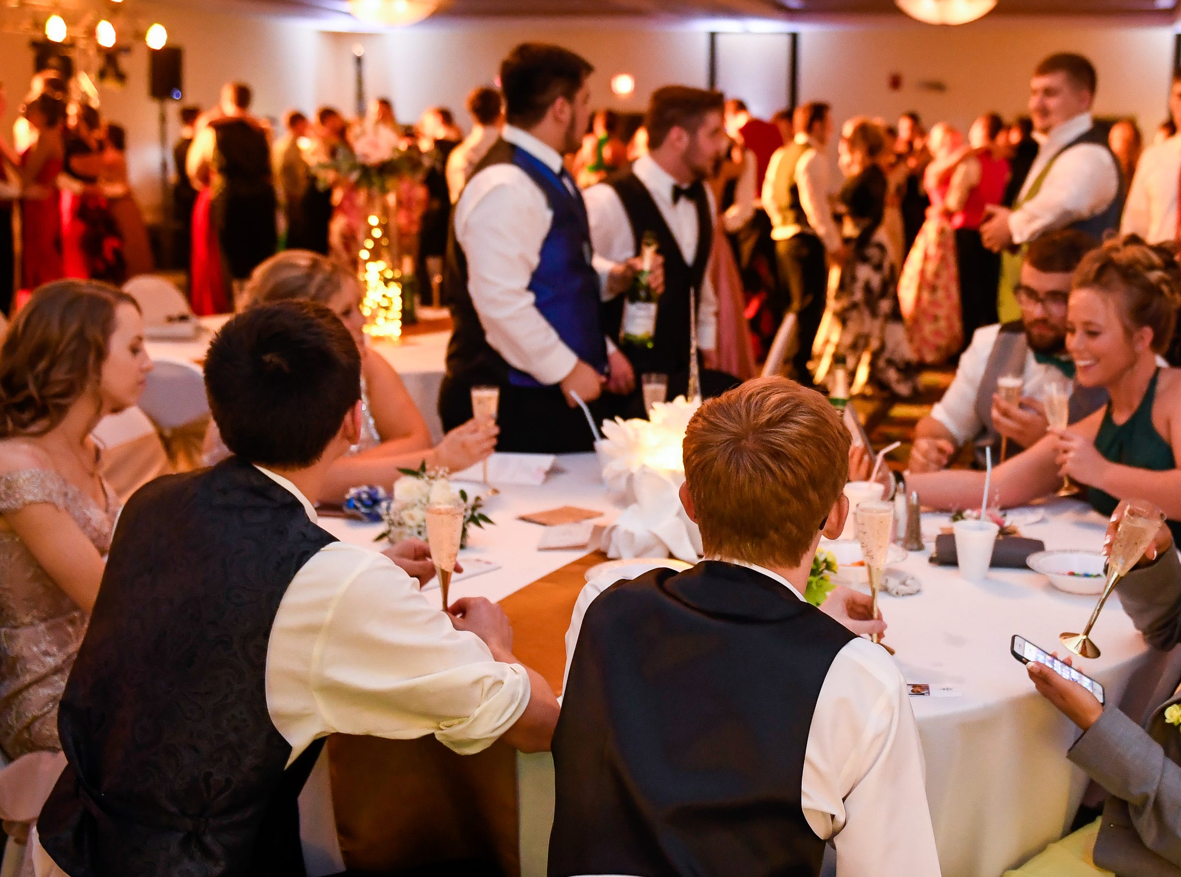 Taking a break between dances at the Tecumseh High School prom held at the Airport Holiday Inn Friday, April 26, 2019.