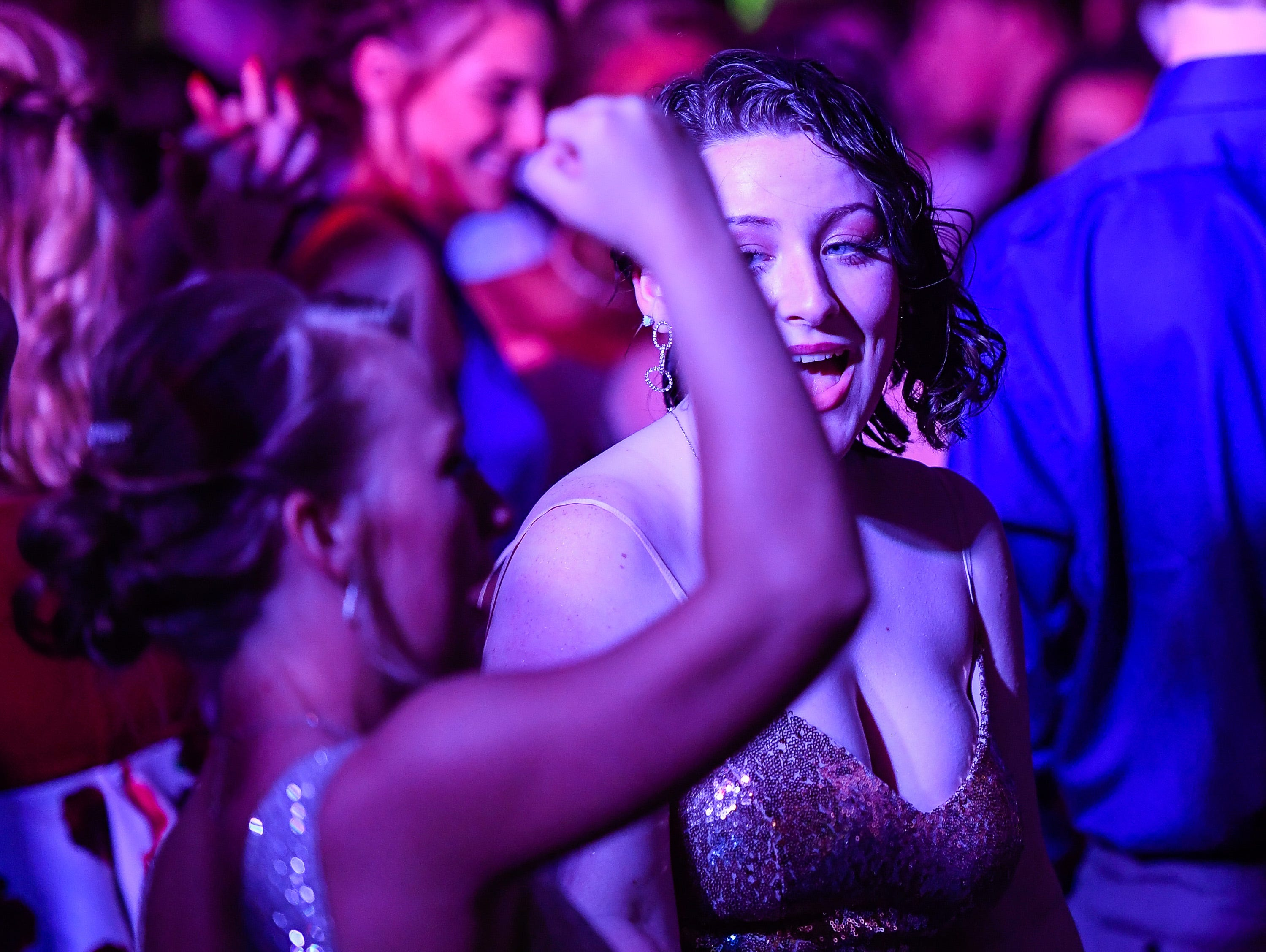 Alex Wagner dances with friends at the Tecumseh High School prom held at the Airport Holiday Inn Friday, April 26, 2019.