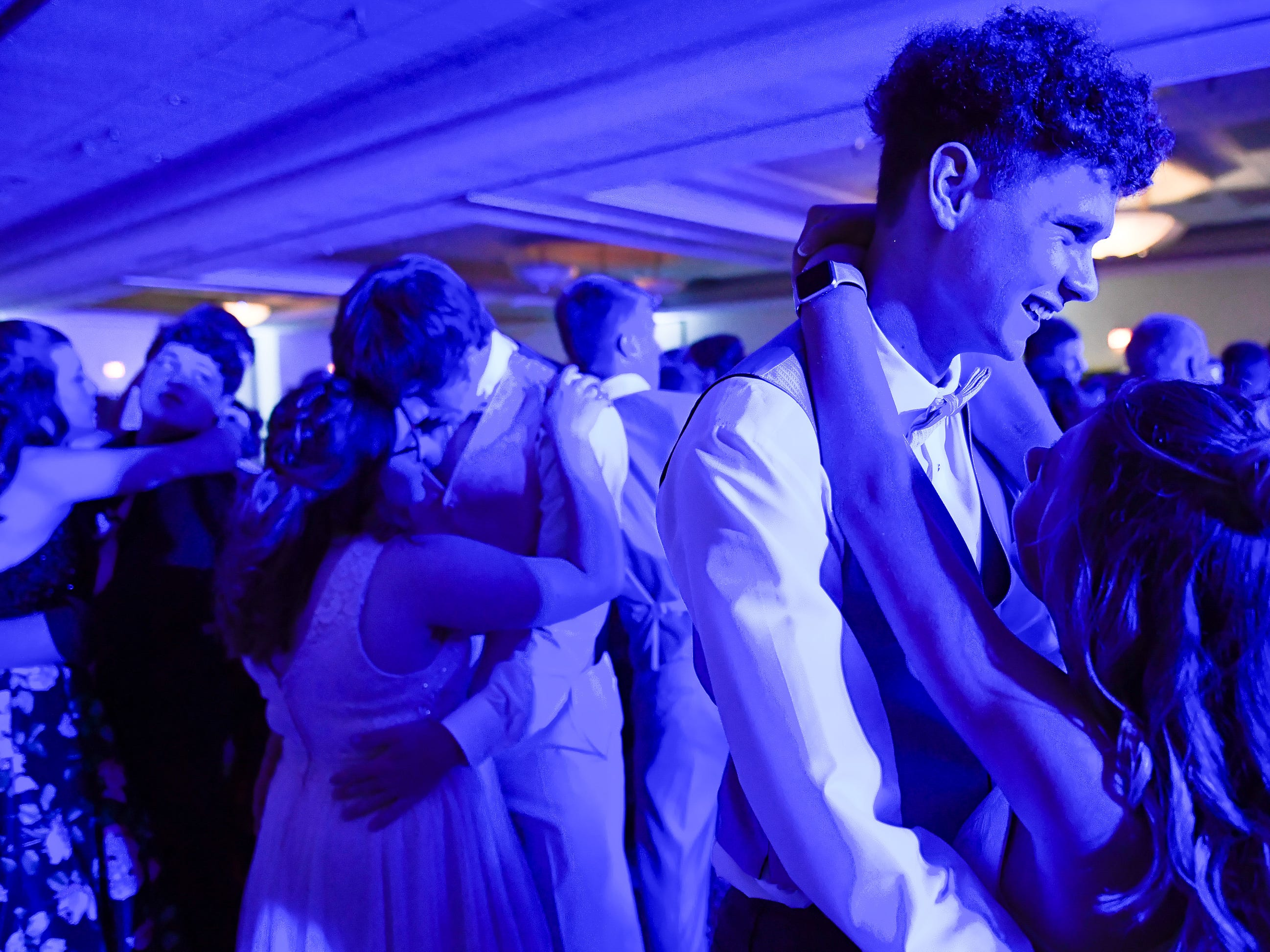 Blue light on the dance floor at the Tecumseh High School prom held at the Airport Holiday Inn Friday, April 26, 2019.