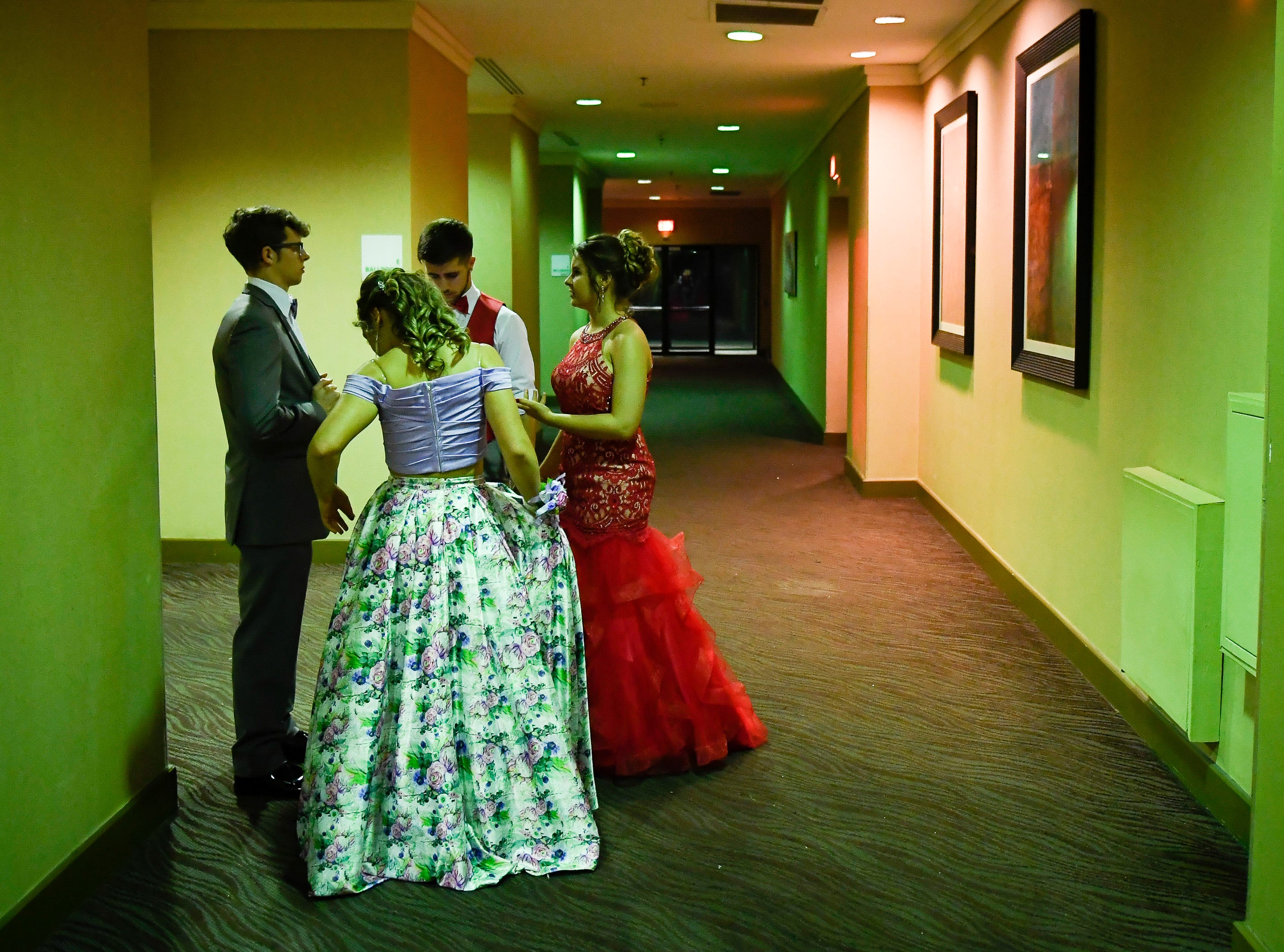 Meeting in the hallway, outside the ballroom, at the Tecumseh High School prom held at the Airport Holiday Inn Friday, April 26, 2019.