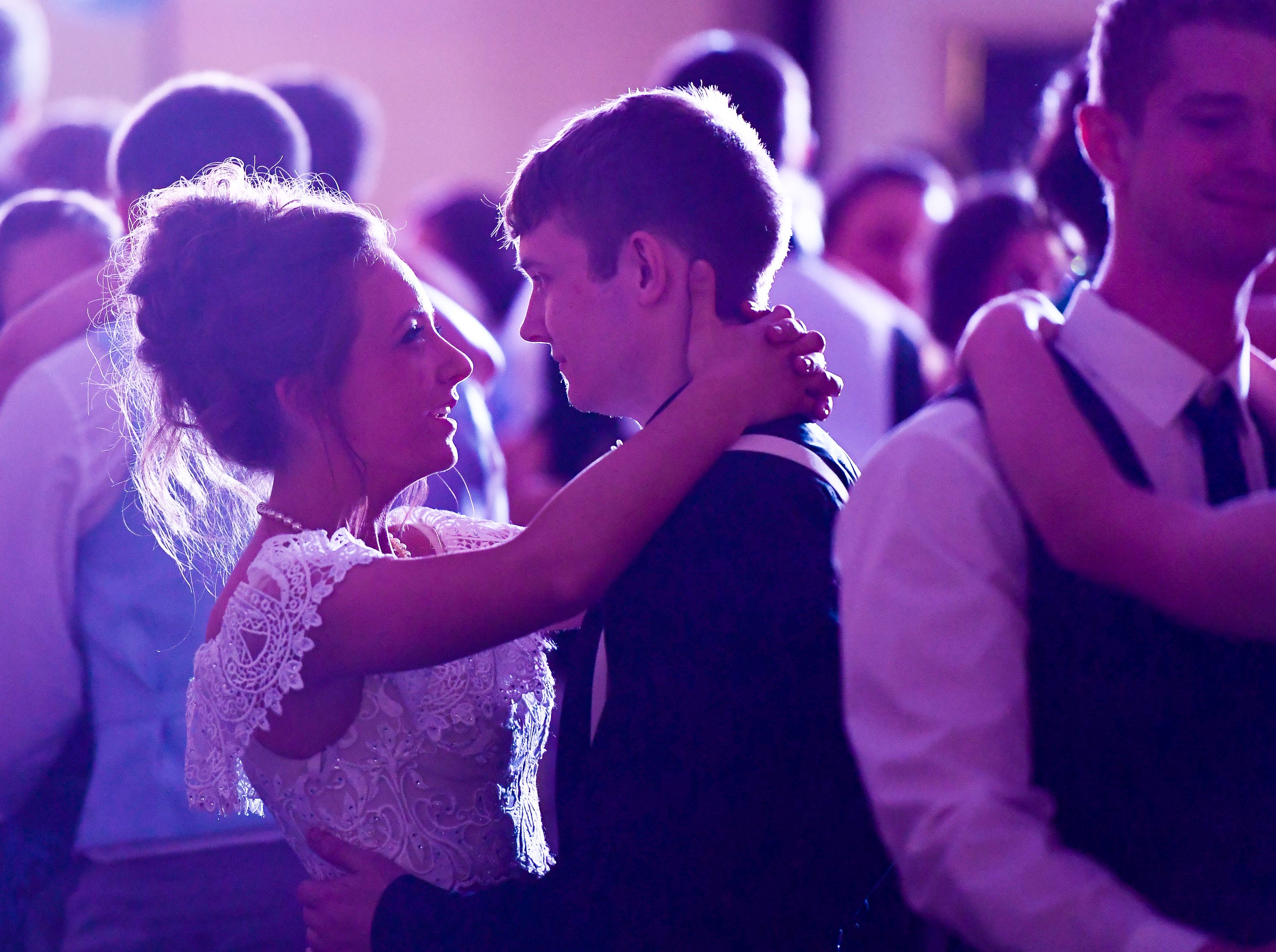 Elizabeth Jost and NIcholes Roy dancing at the Tecumseh High School prom held at the Airport Holiday Inn Friday, April 26, 2019.