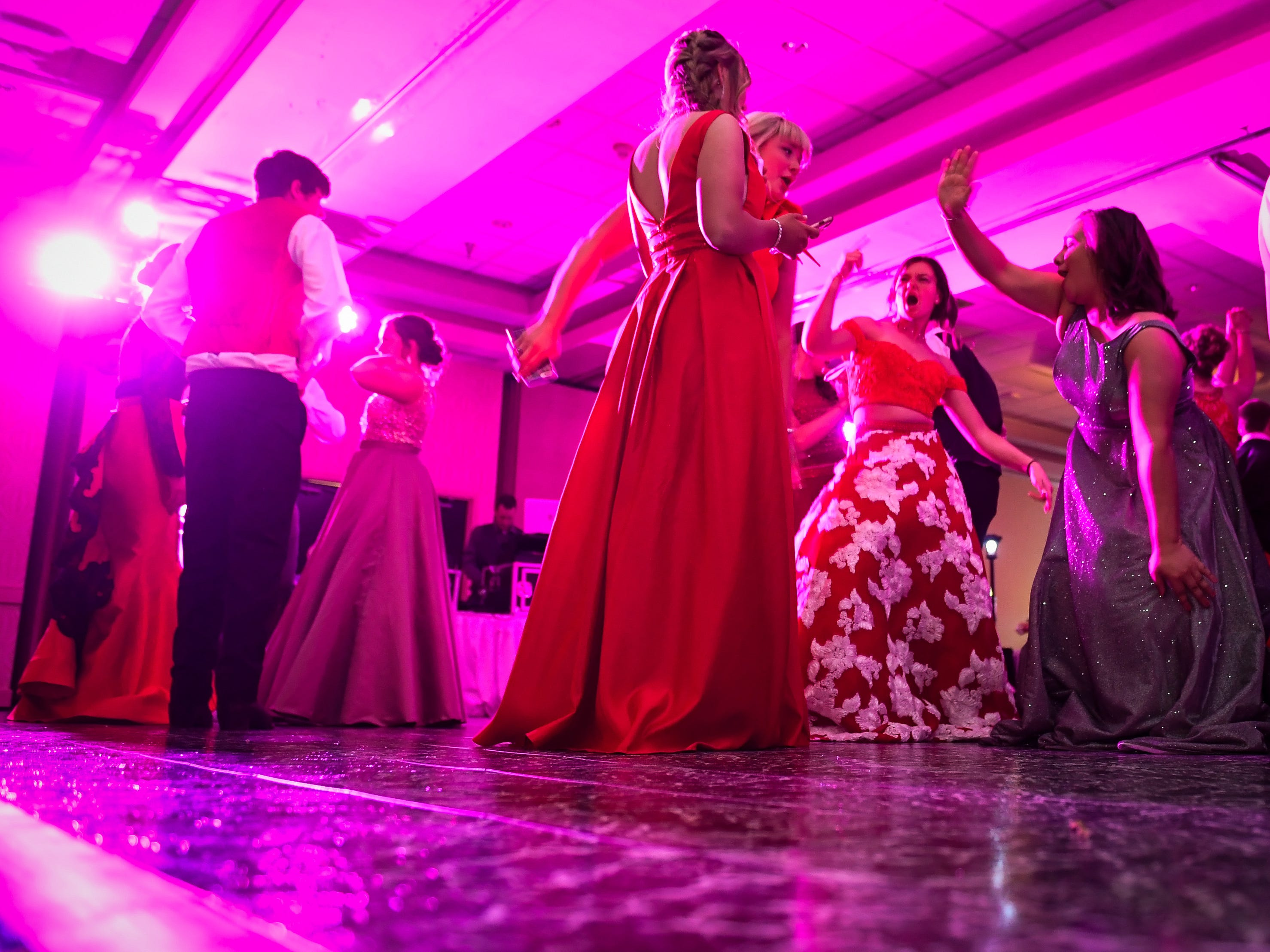 Action on the dance floor at the Tecumseh High School prom held at the Airport Holiday Inn Friday, April 26, 2019.