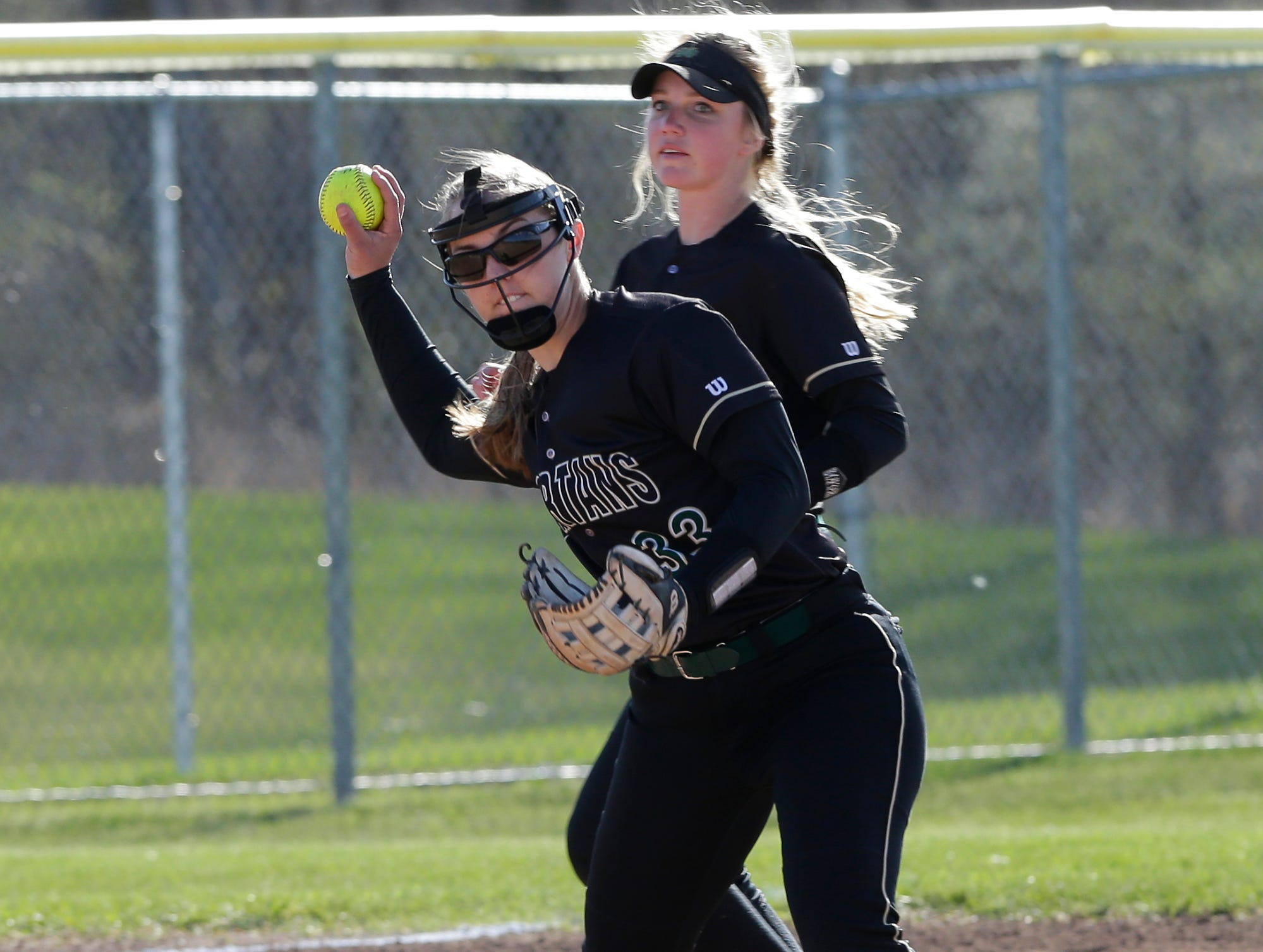Oshkosh North High School softball's Libby Neveau fields a ball against Fond du Lac High School during their game Friday, April 26, 2019 in Fond du Lac, Wis. Doug Raflik/USA TODAY NETWORK-Wisconsin