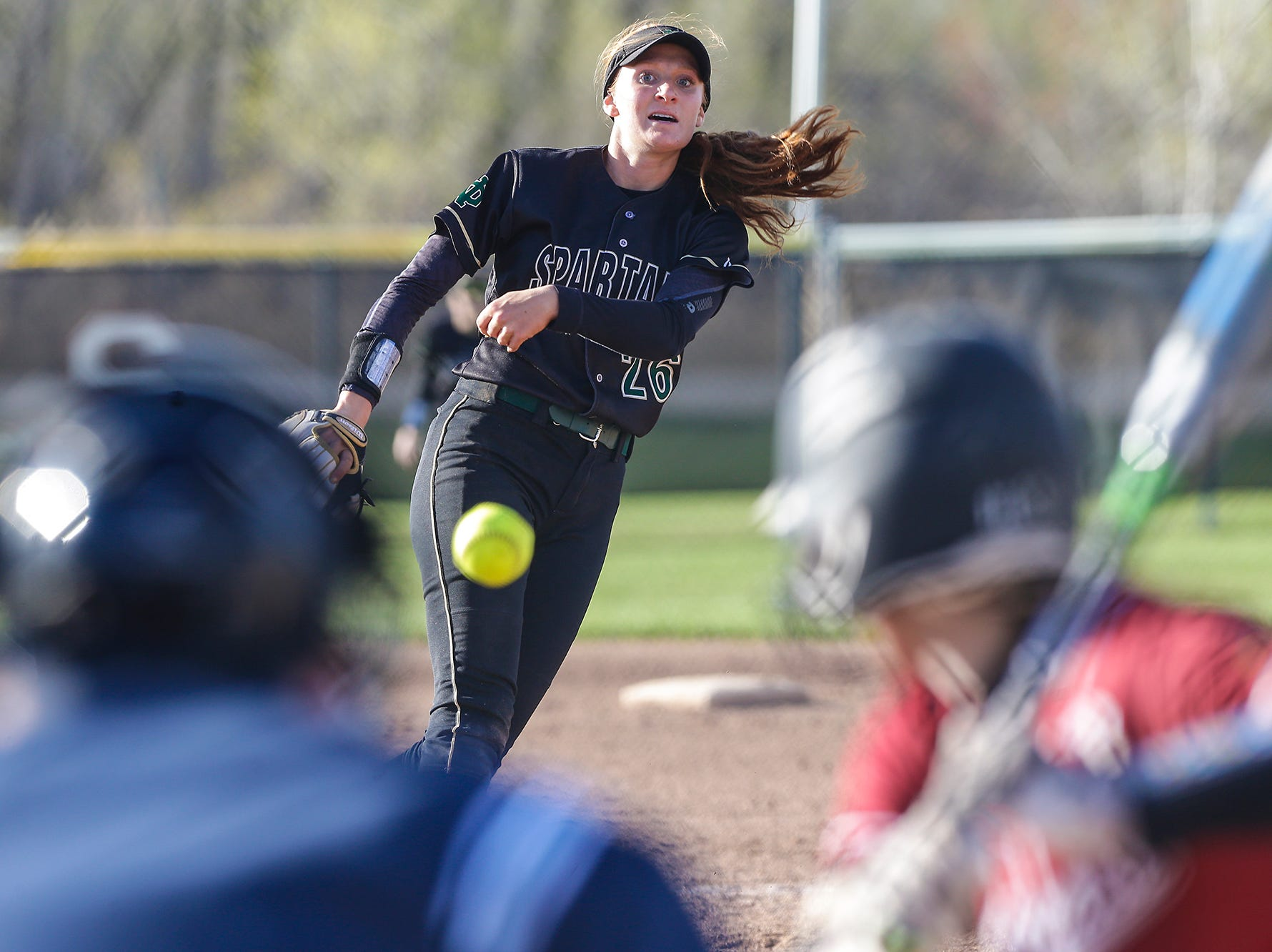 Oshkosh North High School softball's Syd Supple pitches against Fond du Lac High School during their game Friday, April 26, 2019 in Fond du Lac, Wis. Doug Raflik/USA TODAY NETWORK-Wisconsin