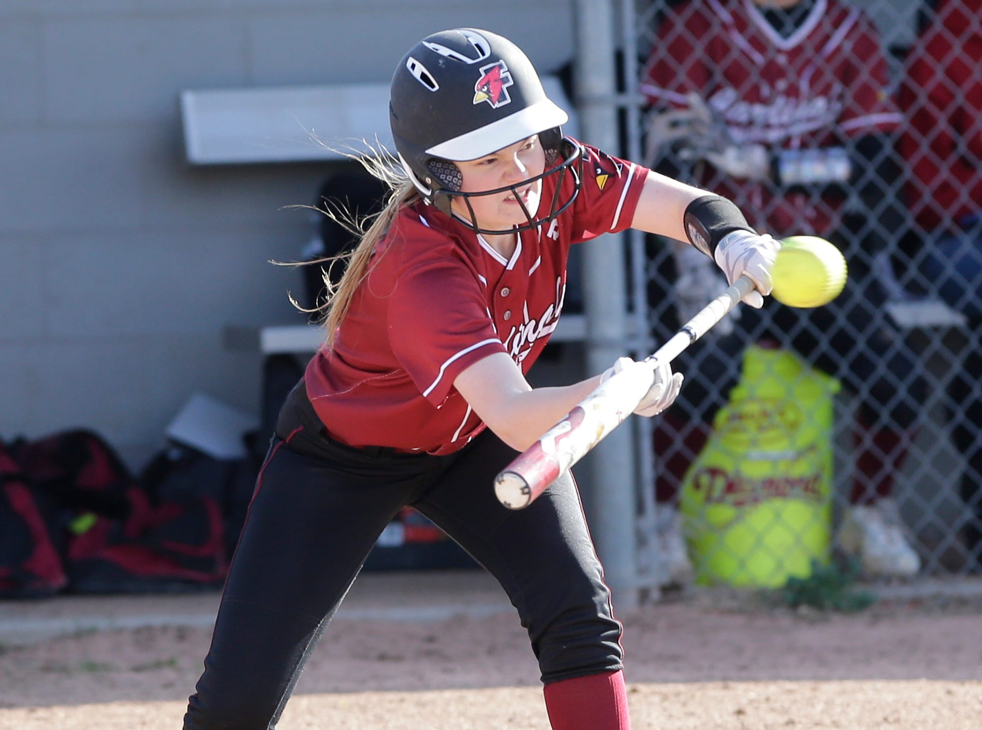 Fond du Lac High School softball's Ramzie Woelfel attempts a bunt against Oshkosh North High School during their game Friday, April 26, 2019 in Fond du Lac, Wis. Doug Raflik/USA TODAY NETWORK-Wisconsin
