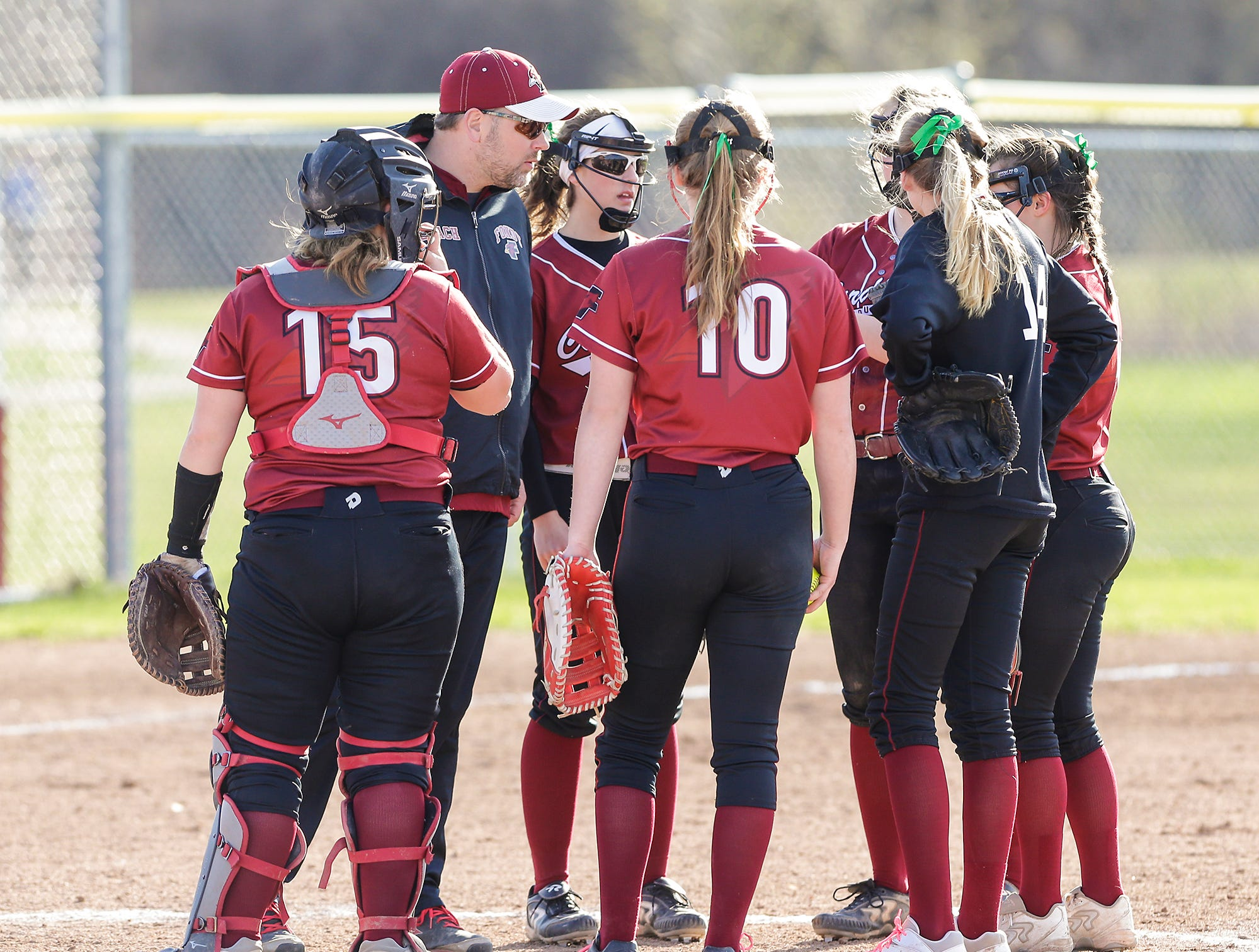 Fond du Lac High School softball's coach Adam Rushing talks with members of his team during their game against Oshkosh North High School  Friday, April 26, 2019 in Fond du Lac, Wis. Doug Raflik/USA TODAY NETWORK-Wisconsin
