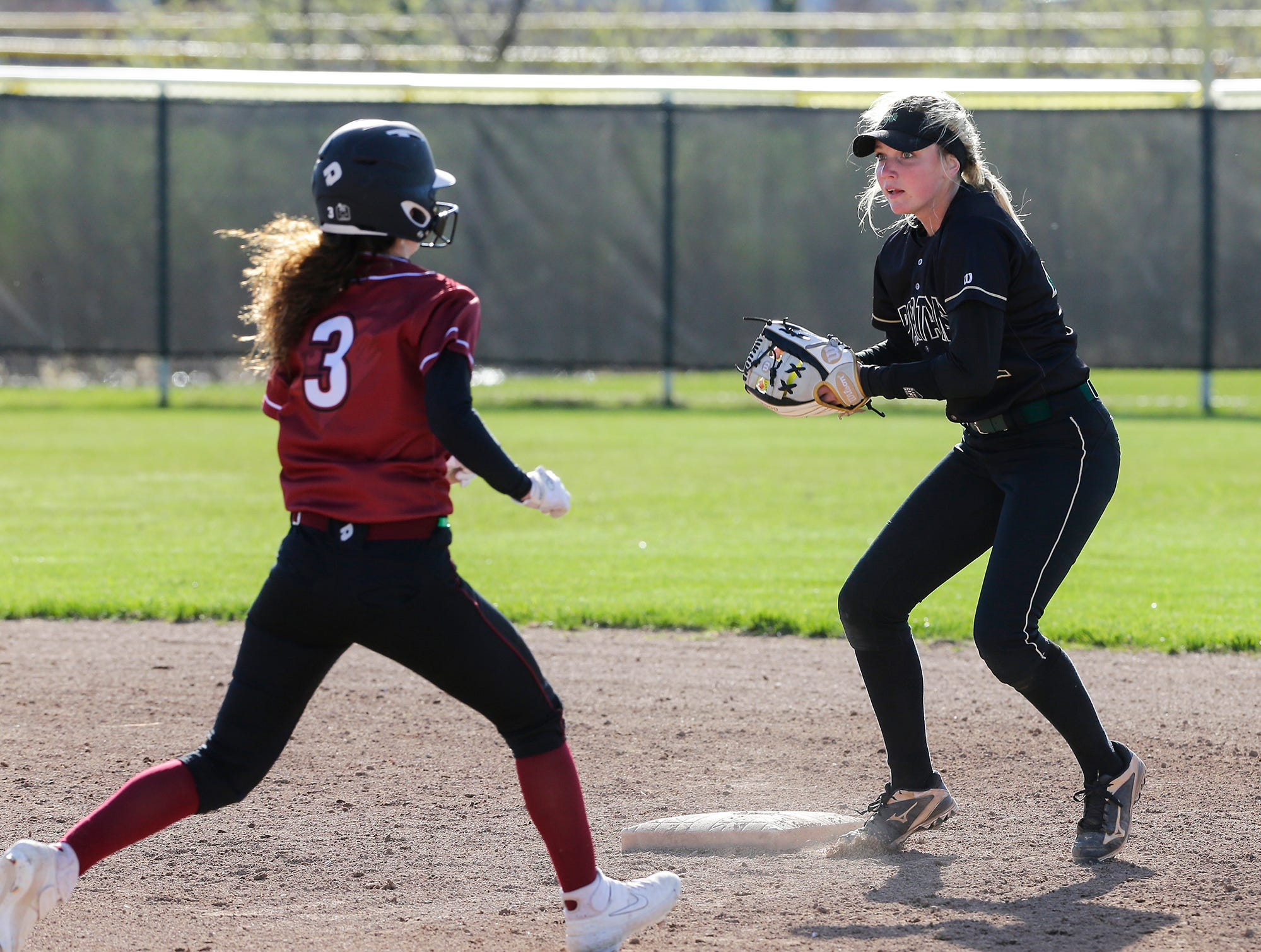 Oshkosh North High School softball's Brooke Ellestad attempts to force out Fond du Lac High School's Brianna Biermann but never touches the base during their game Friday, April 26, 2019 in Fond du Lac, Wis. Doug Raflik/USA TODAY NETWORK-Wisconsin