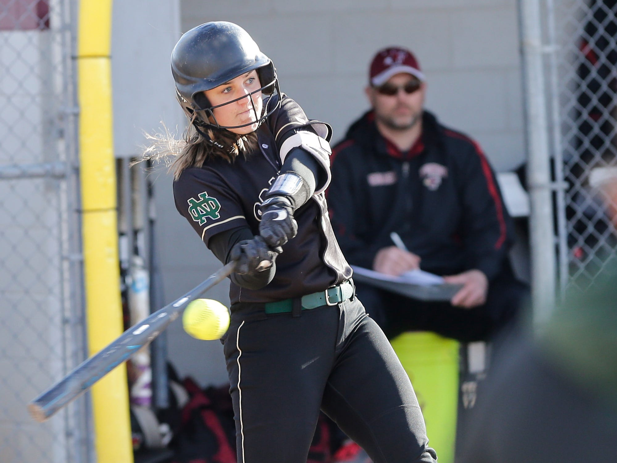 Oshkosh North High School softball's Libby Meveau swings at a pitch against Fond du Lac High School during their game Friday, April 26, 2019 in Fond du Lac, Wis. Doug Raflik/USA TODAY NETWORK-Wisconsin