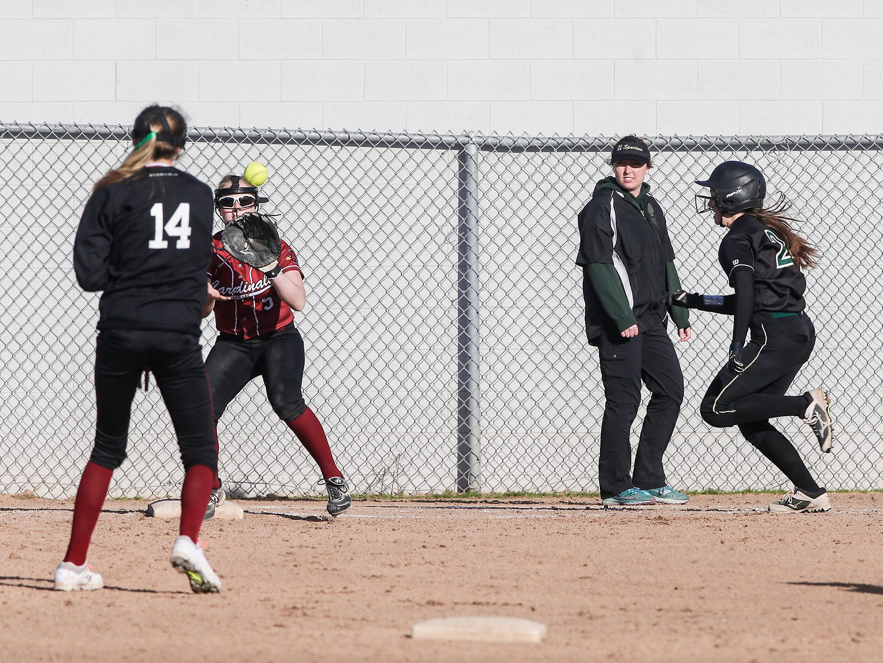 Fond du Lac High School softball's Nyah Odekirk (14) throws to Brianna Biermann (3) to tag out Oshkosh North High School's Emma Leib (24) during their game Friday, April 26, 2019 in Fond du Lac, Wis. Doug Raflik/USA TODAY NETWORK-Wisconsin