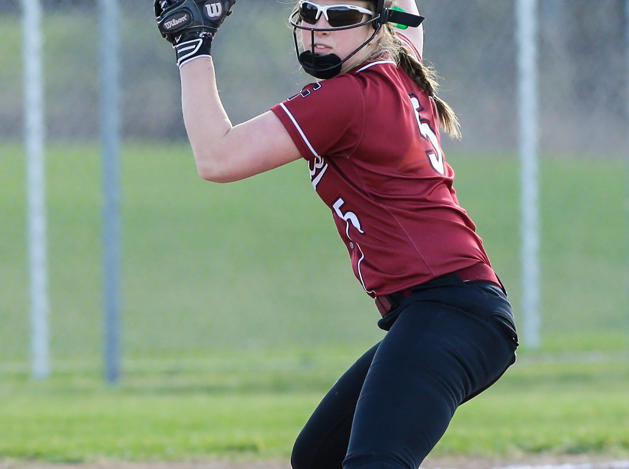 Fond du Lac High School softball's Kellie Hierl fields a ball against Oshkosh North High School during their game Friday, April 26, 2019 in Fond du Lac, Wis. Doug Raflik/USA TODAY NETWORK-Wisconsin