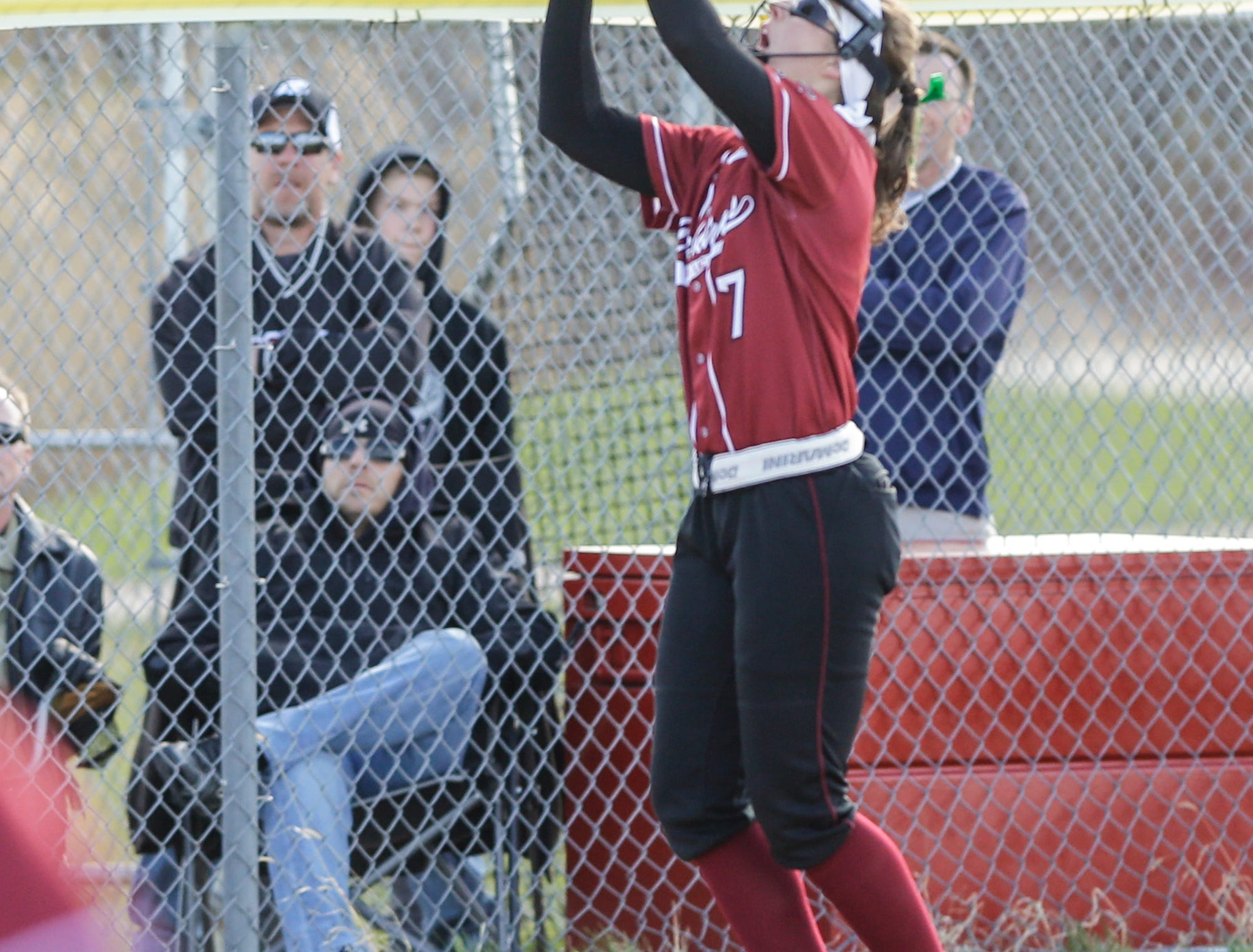 Fond du Lac High School softball's Kali Smit catches a pop up foul ball against Oshkosh North High School during their game Friday, April 26, 2019 in Fond du Lac, Wis. Doug Raflik/USA TODAY NETWORK-Wisconsin