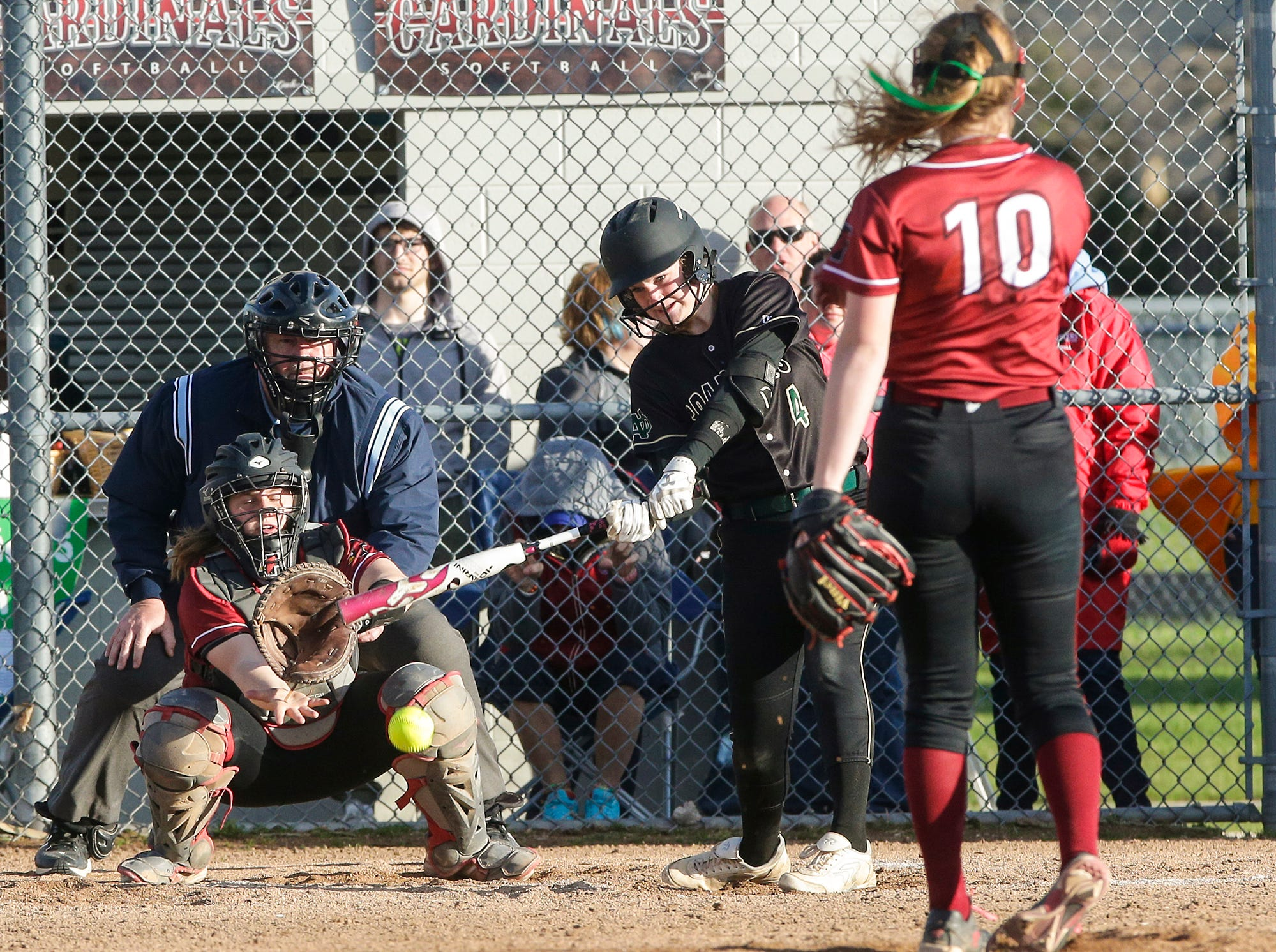 Oshkosh North High School softball's Noelle Frank drives in a run with this single against Fond du Lac High School during their game Friday, April 26, 2019 in Fond du Lac, Wis. Doug Raflik/USA TODAY NETWORK-Wisconsin