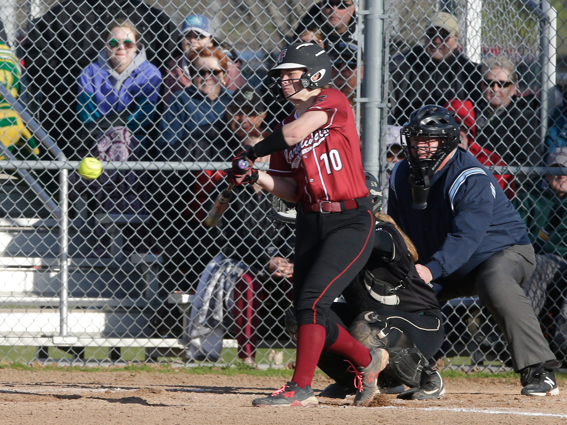 Fond du Lac High School softball's Morgan Flaherty swings at a pitch against Oshkosh North High School during their game Friday, April 26, 2019 in Fond du Lac, Wis. Doug Raflik/USA TODAY NETWORK-Wisconsin