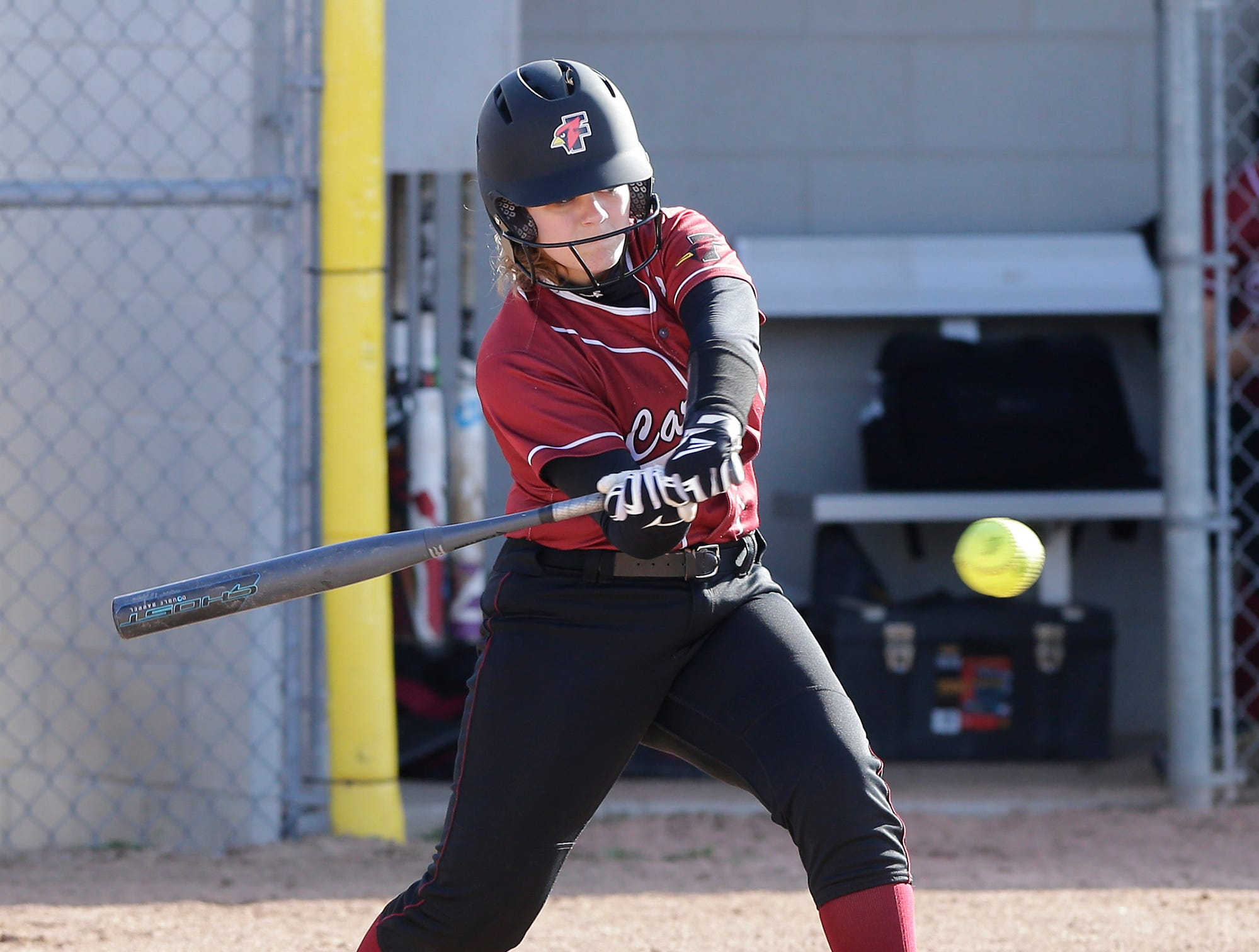Fond du Lac High School softball's Emilee Simon swings at a pitch against Oshkosh North High School during their game Friday, April 26, 2019 in Fond du Lac, Wis. Doug Raflik/USA TODAY NETWORK-Wisconsin