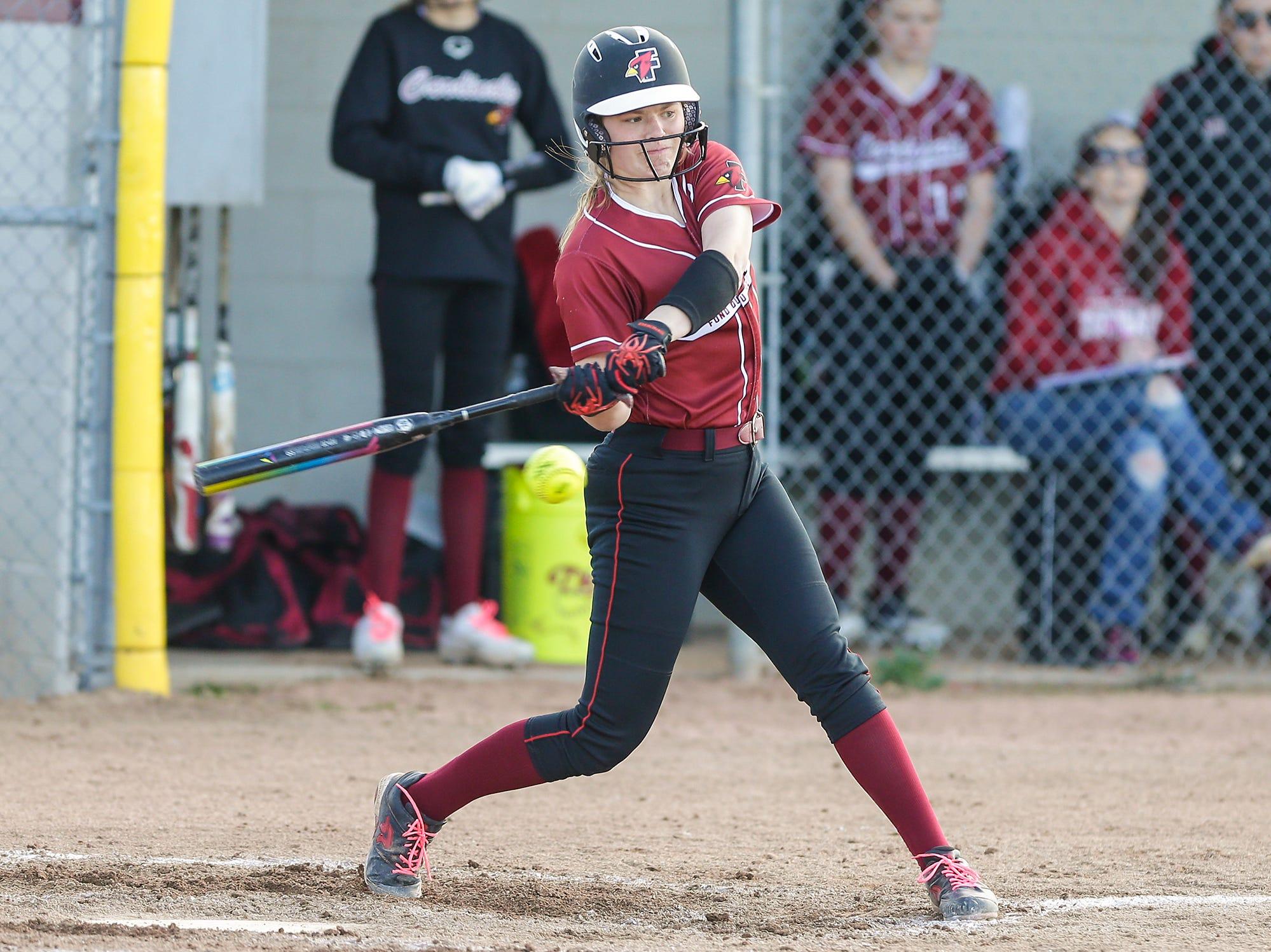 Fond du Lac High School softball's Morgan Flaherty hits a run scoring single against Oshkosh North High School during their game Friday, April 26, 2019 in Fond du Lac, Wis. Doug Raflik/USA TODAY NETWORK-Wisconsin