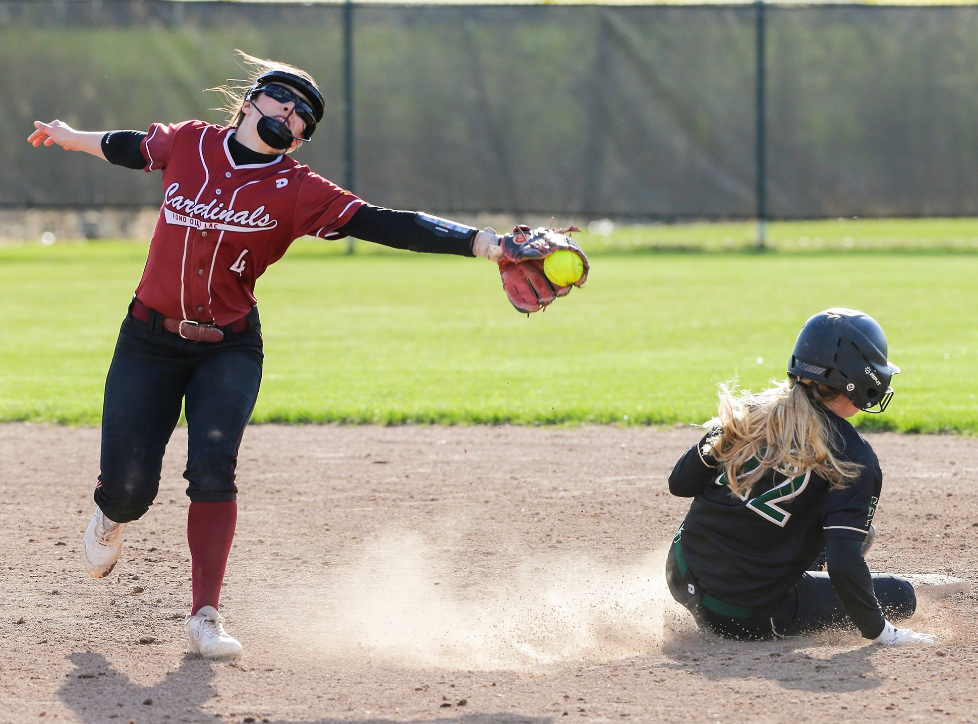 Fond du Lac High School softball's Abby Freismuth misses a tag against Oshkosh North High School's Brooke Ellstad as she steals second base during their game Friday, April 26, 2019 in Fond du Lac, Wis. Doug Raflik/USA TODAY NETWORK-Wisconsin