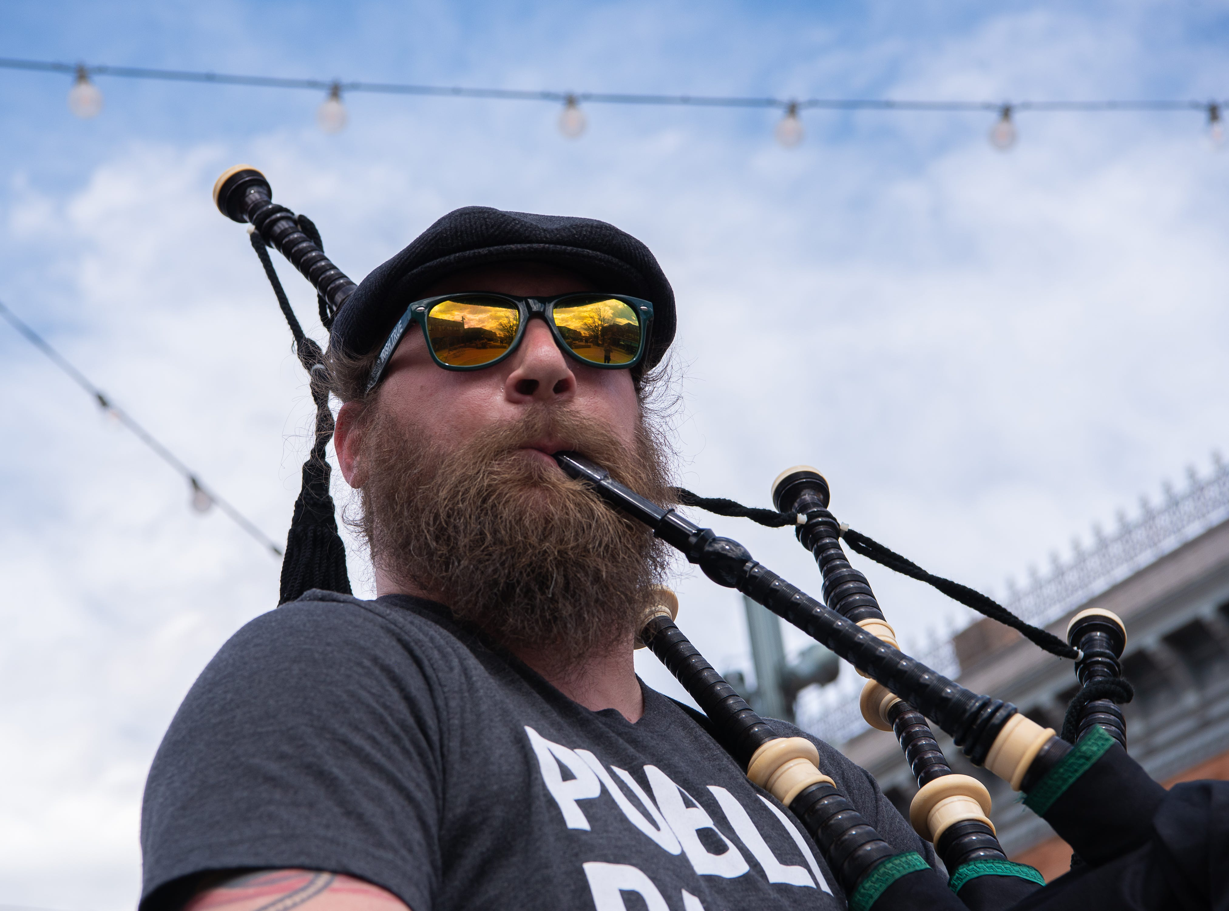 Desmond O'Boyle plays the Great Highland bagpipe  for the kickoff of the FoCoMX XI music festival in Old Town Square on Friday, April 26, 2019, in Fort Collins, Colo.