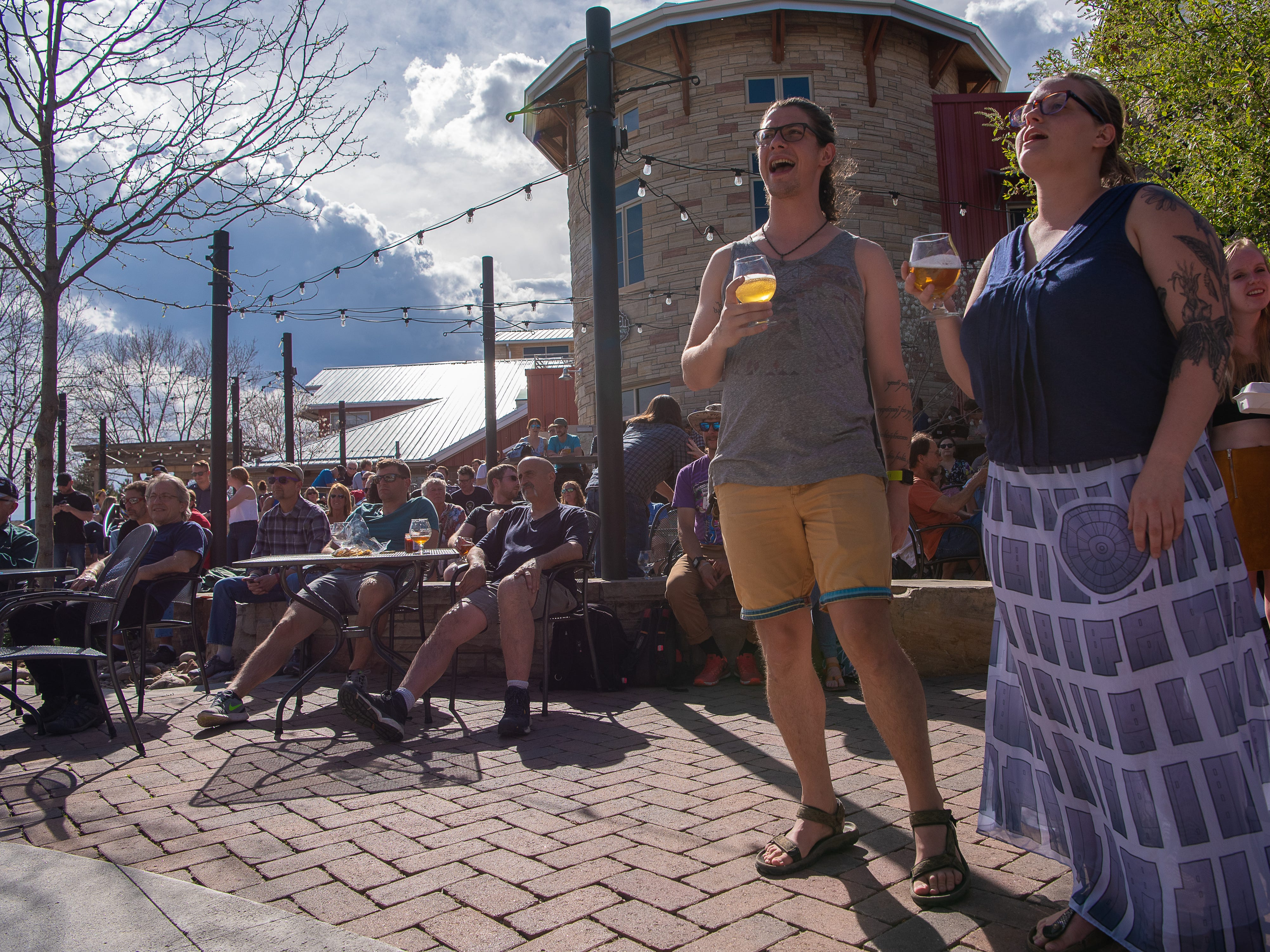 Eddy Anderson and Sienna Valente-Blough enjoy a set by No Doubt About It at Odell Brewing Co. during the FoCoMX XI music festival on Friday, April 26, 2019, in Fort Collins, Colo.