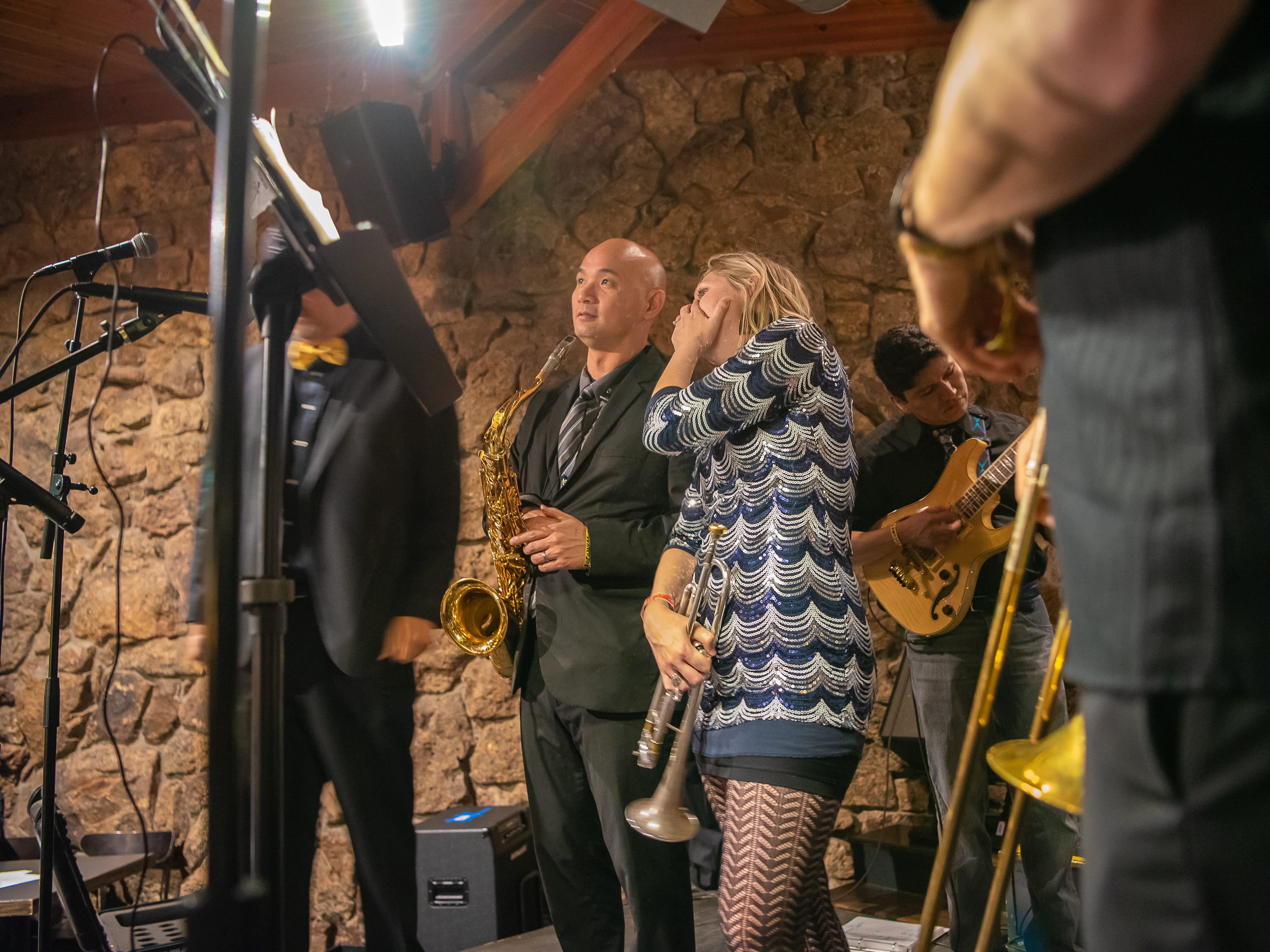 Members of Choice City Seven exchange a few words before a performance at The Mayor of Old Town during the FoCoMX XI music festival on Friday, April 26, 2019, in Fort Collins, Colo.