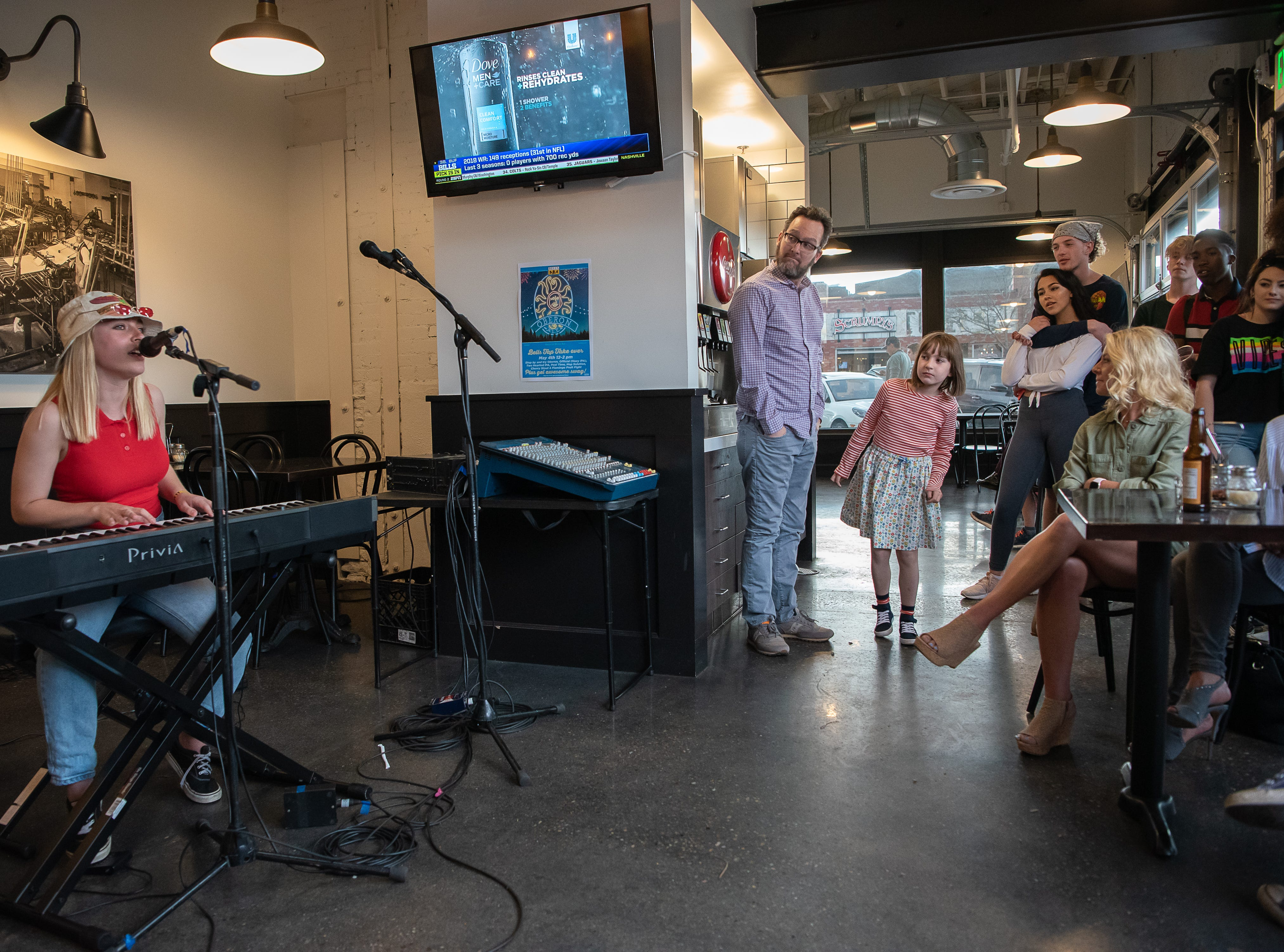 A standing room crowd listens to Cecilia at The Pizza Press during the FoCoMX XI music festival on Friday, April 26, 2019, in Fort Collins, Colo.