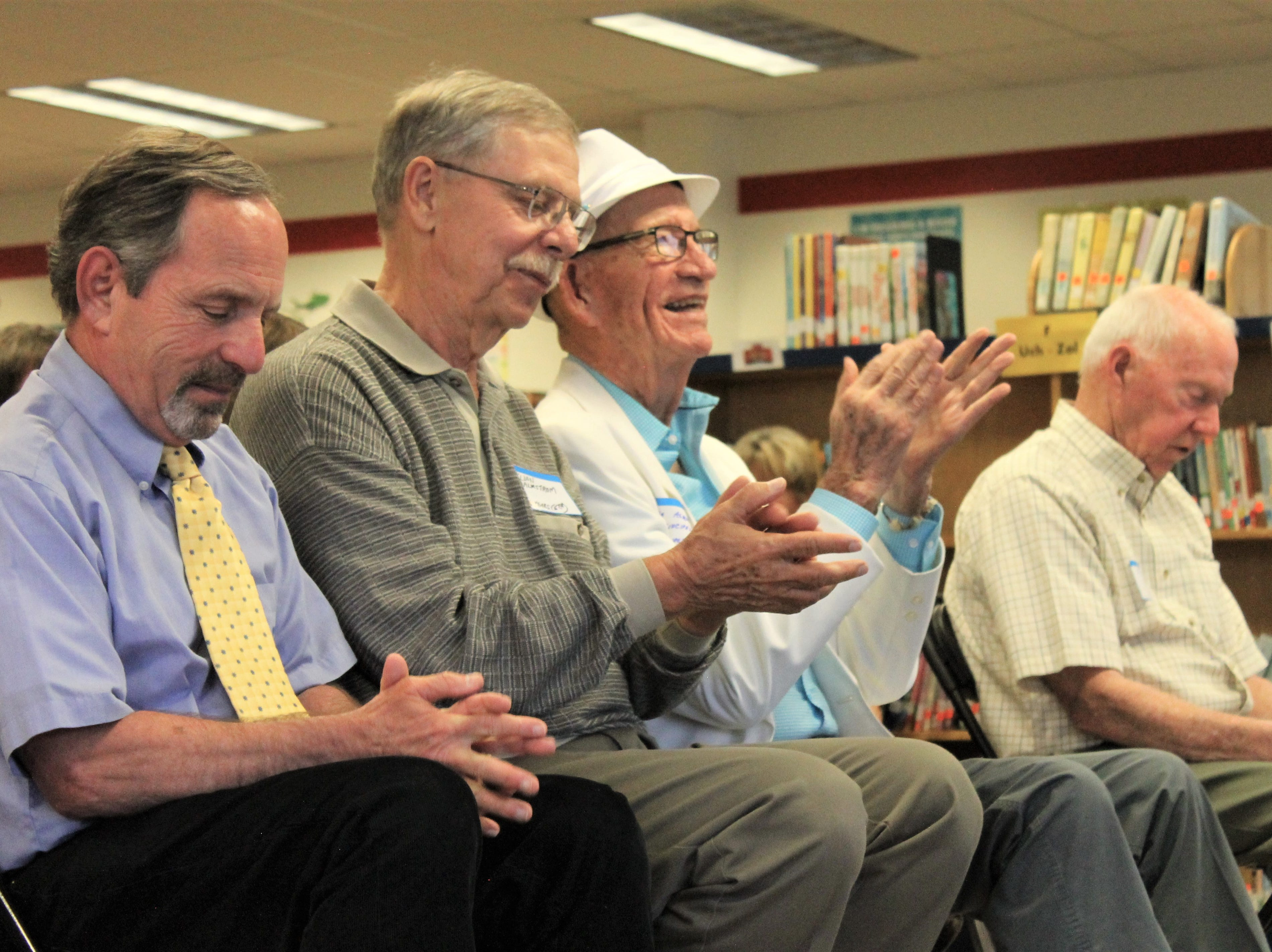 David Hodge, former principal, Eldon Malmstrom, former teacher, Bob Asmus, former principal, and Paul Huff, former principal sit in the front row Friday, April 26, 2019 at Riffenburgh Elementary School's 50th anniversary celebration.