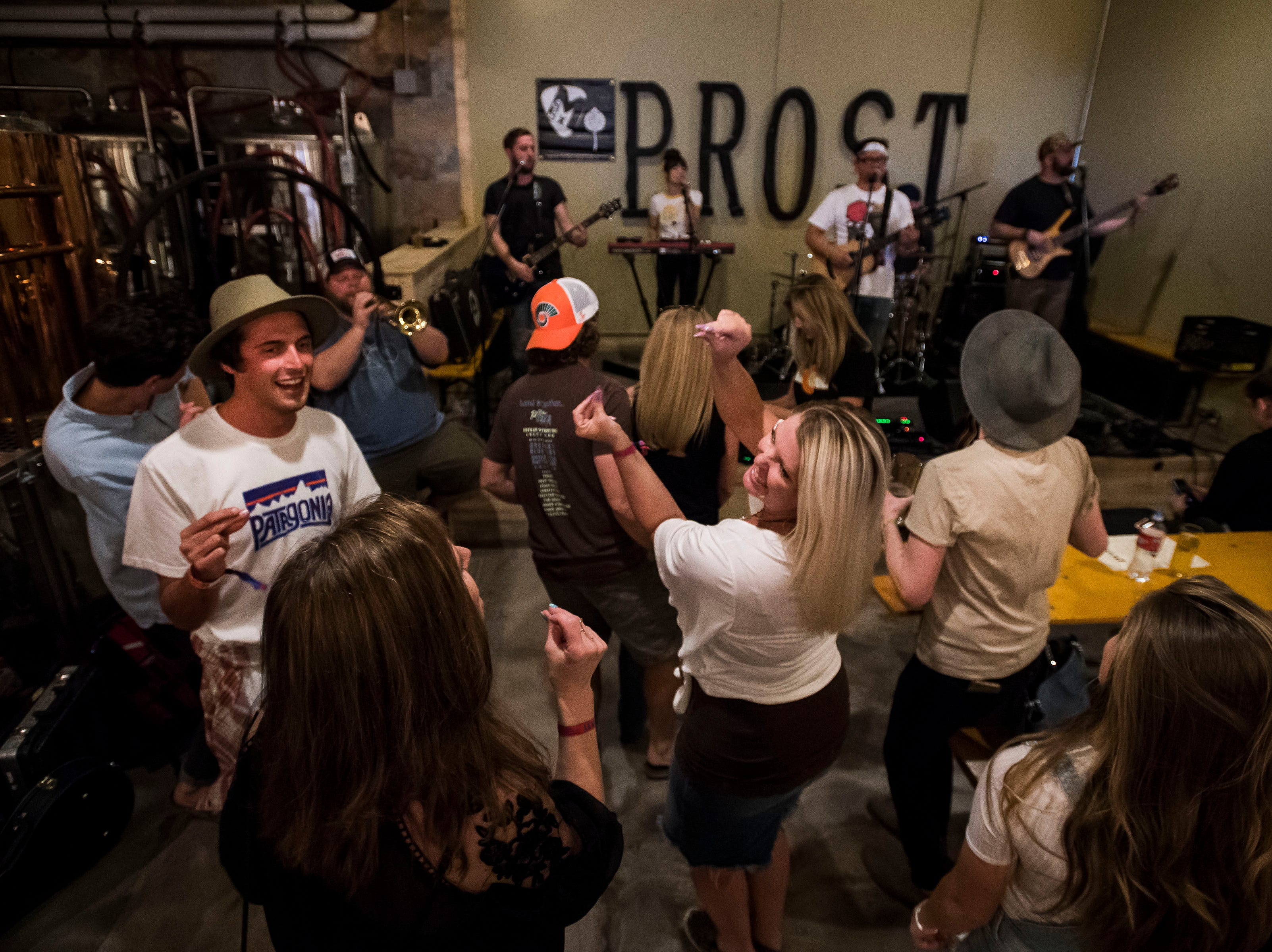 Audience member dance as Lola Rising plays at Prost Brewing Co. and Biergarten during the FoCoMX XI music festival on Friday, April 26, 2019, in Fort Collins, Colo.