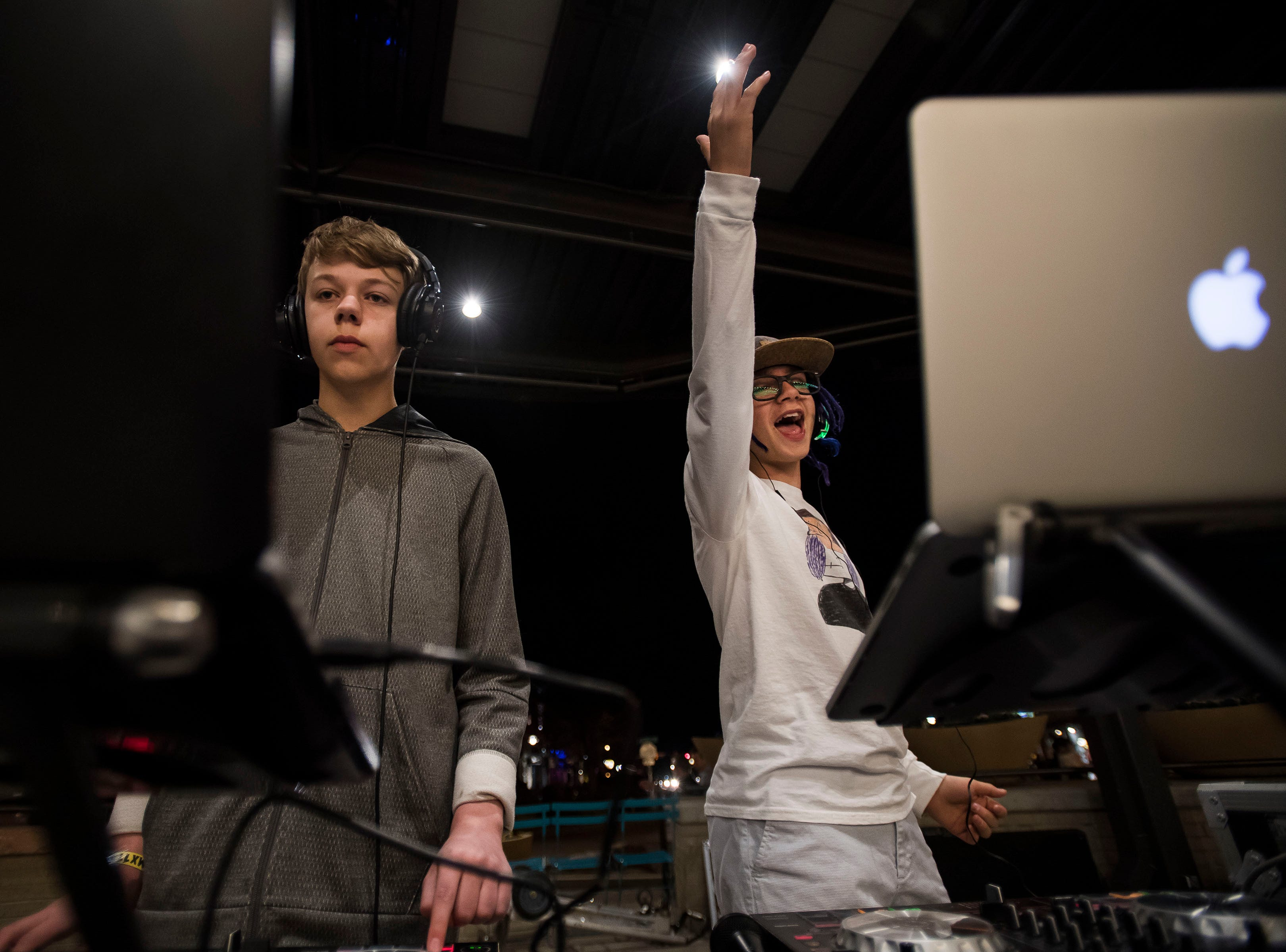 DJs NOLLIJ, left and Blakeye, right, perform at the Sound Off Silent Disco at Old Town Square during the FoCoMX XI music festival on Friday, April 26, 2019, in Fort Collins, Colo.