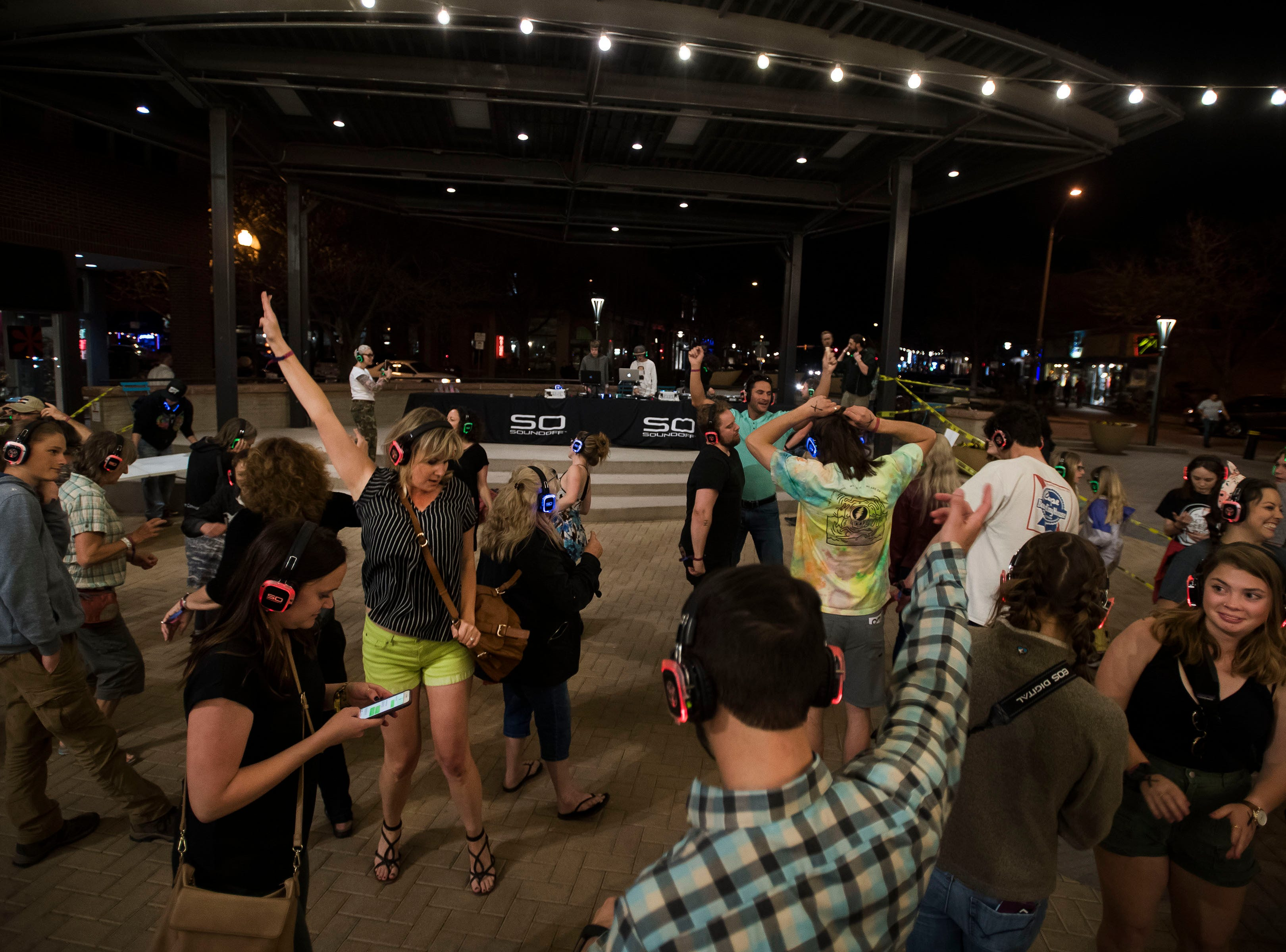 Audience members dance at the Sound Off Silent Disco at Old Town Square during the FoCoMX XI music festival on Friday, April 26, 2019, in Fort Collins, Colo.