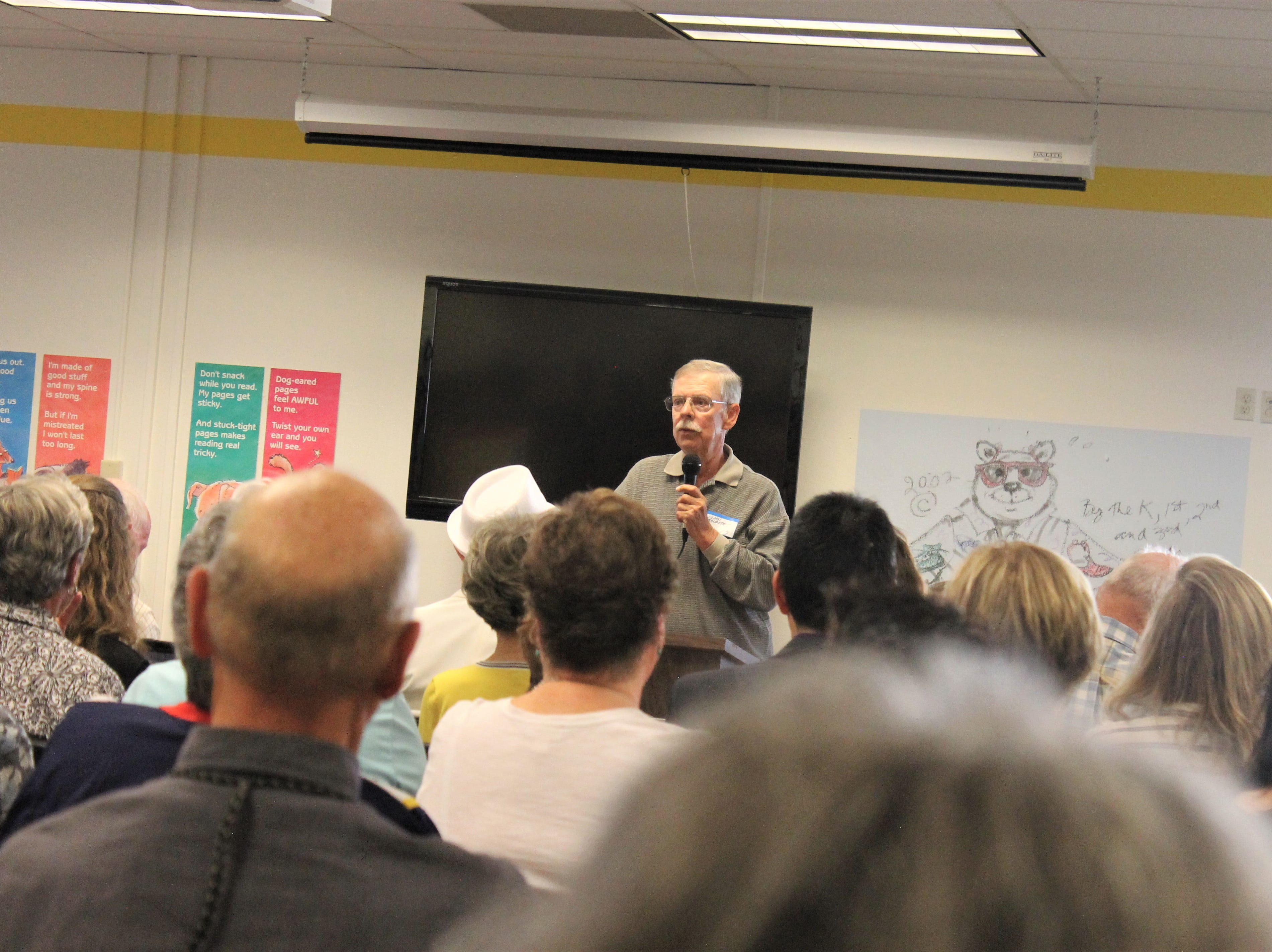 Eldon Malmstrom speaks to a crowd in Riffenburgh Elementary School's library Friday, April 26, 2019 as part of the school's 50th anniversary celebration.