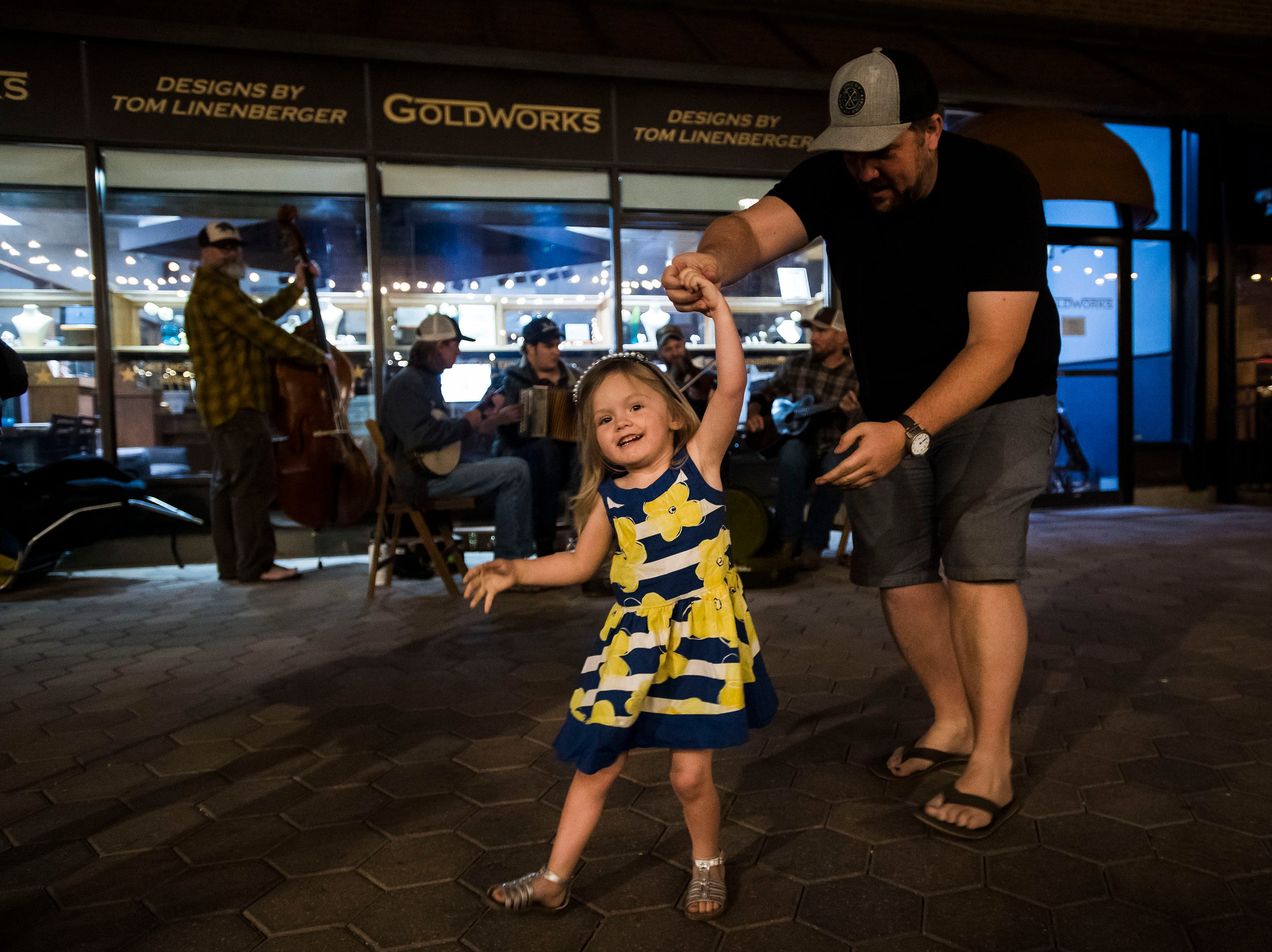 Rylin Sturdevant, 3, spins while dancing with her father Thayne Sturdevant to The New Pleasant Valley String Band during the FoCoMX XI music festival on Friday, April 26, 2019, in Fort Collins, Colo.