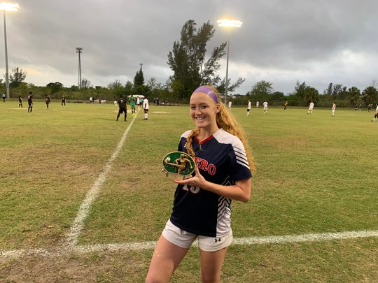 Following her five goal game, Estero's Maggie Struble smiles with her MVP trophy.